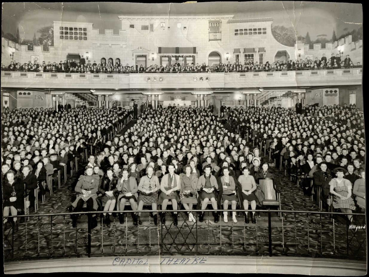 A packed Capitol auditorium around 1940. The projection booth is dead centre, above the loges. (Saskatoon Public Library Local History Room; item PH-88-591)