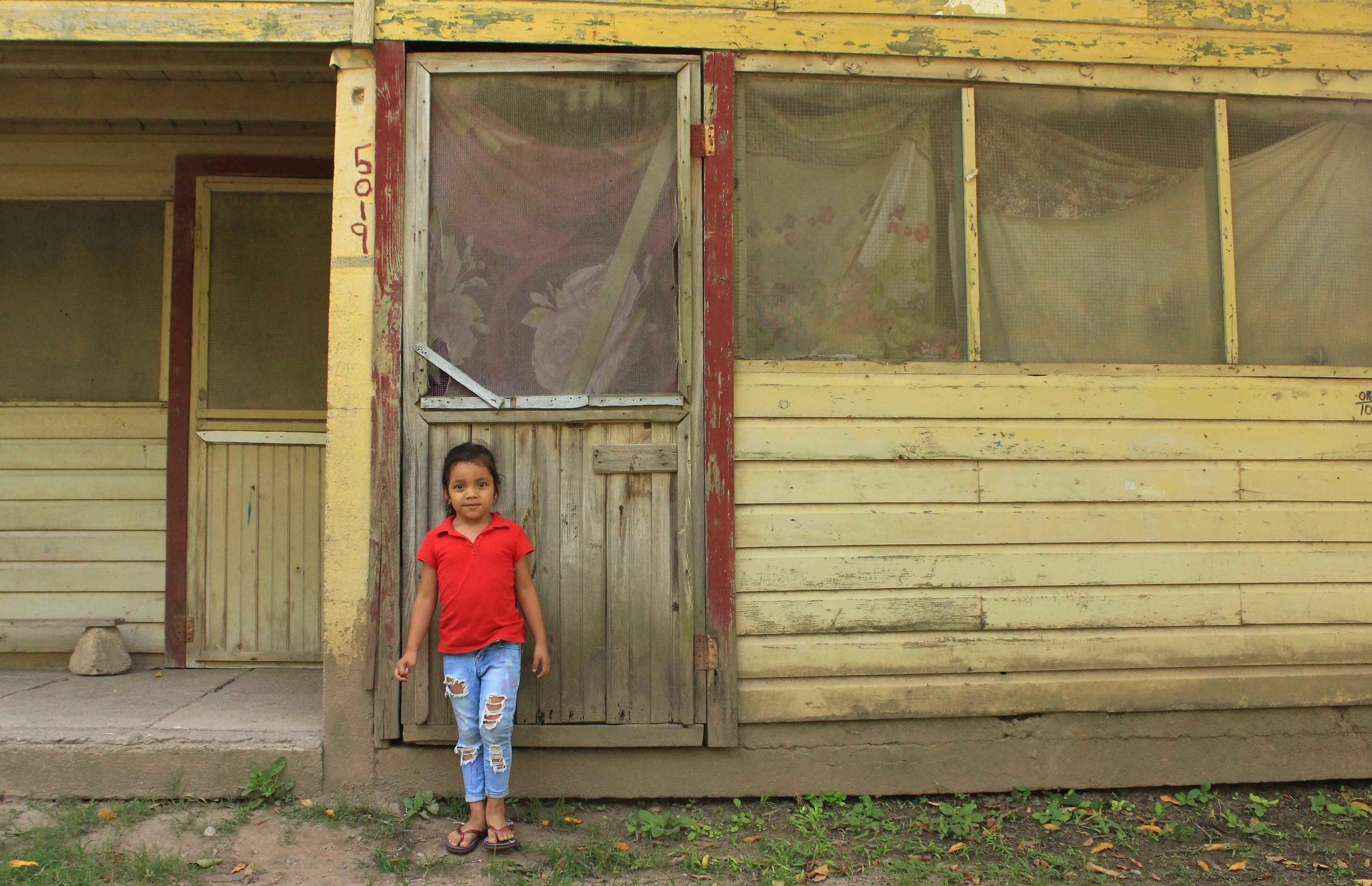 Some farmers and their families, like six-year-old Camila Sofía Martínez Bonilla, are still living in the barracks that line the northern coast of Honduras. (María José Burgos/CBC)