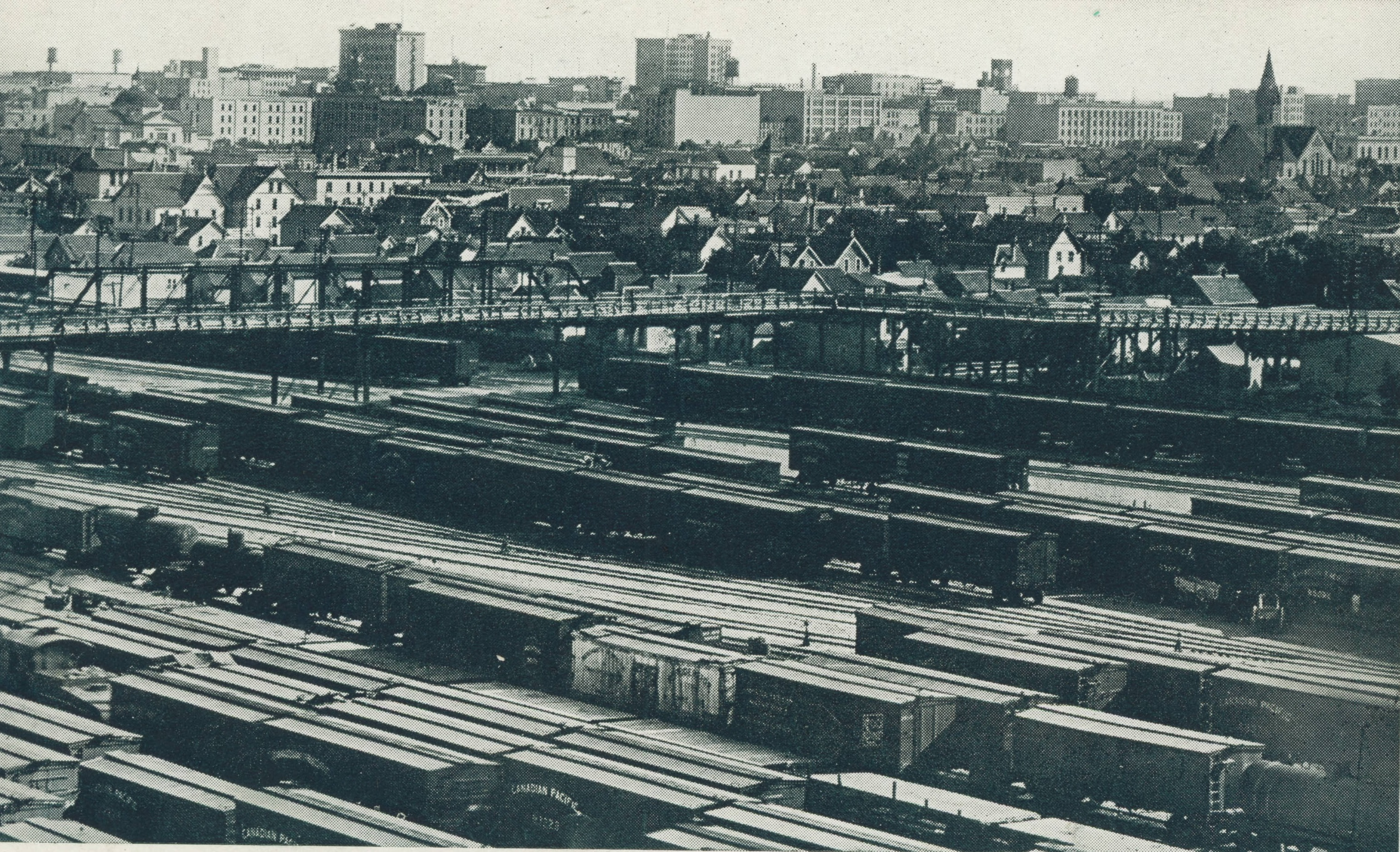 The Salter Street Bridge (now the Slaw Rebchuk Bridge) passes over the CP Rail yards in this photo taken sometime between 1904 and 1911. The photographer is in the working-class North End, which the railway cut off from downtown and wealthy south Winnipeg, where the Union Bank Tower reaches into the sky, left of centre on the horizon. Knox Presbyterian Church, now Knox United, is on the right.
