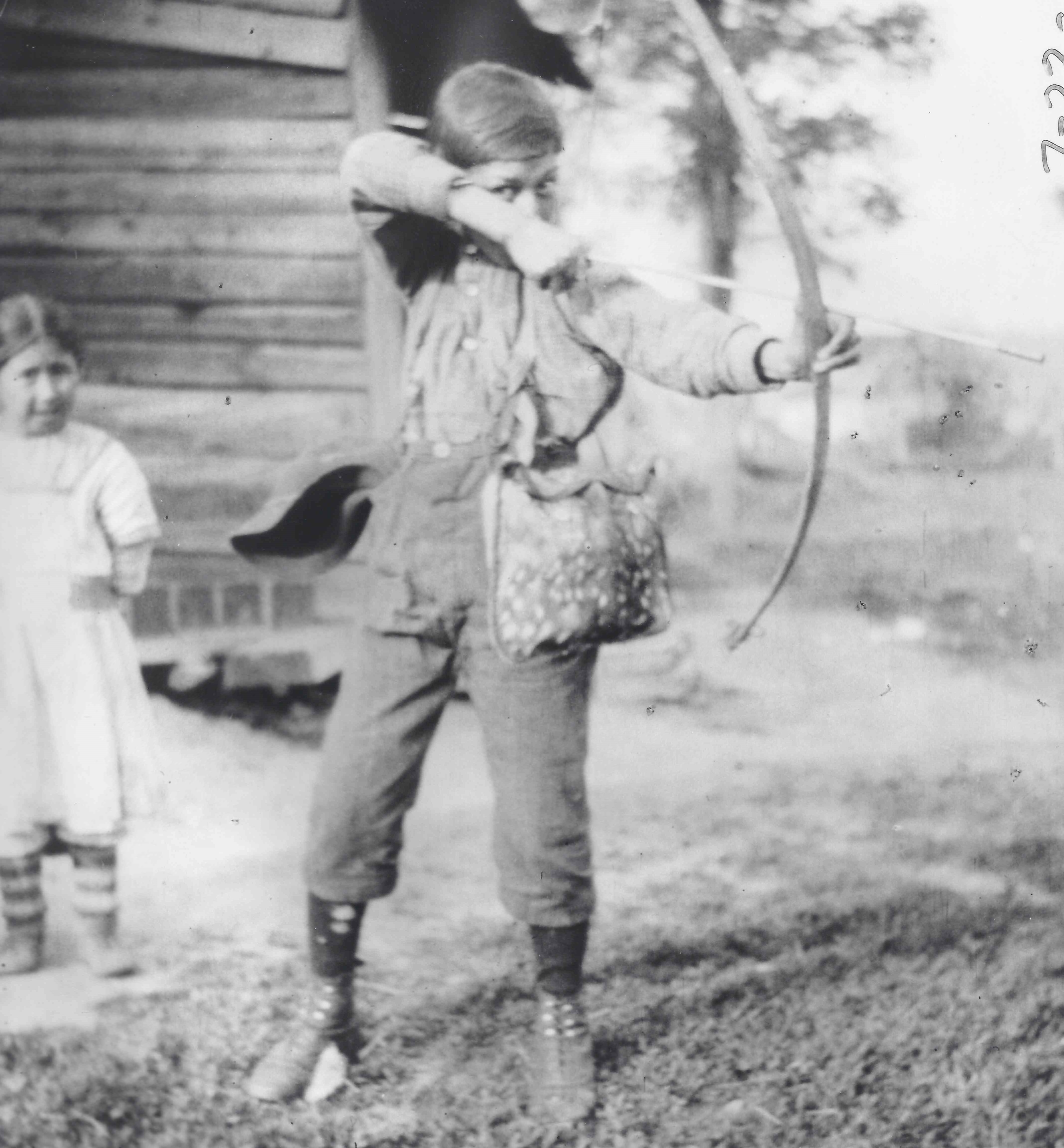 Boy with bow and arrow — Timiskaming circa 1913. (Frank Speck/American Philosophical Society)