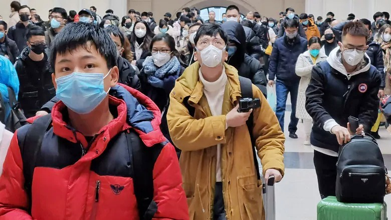 People wear face masks as they wait at Hankou Railway Station in Wuhan, China, in early January. (Xiaolu Chu/Getty Images)