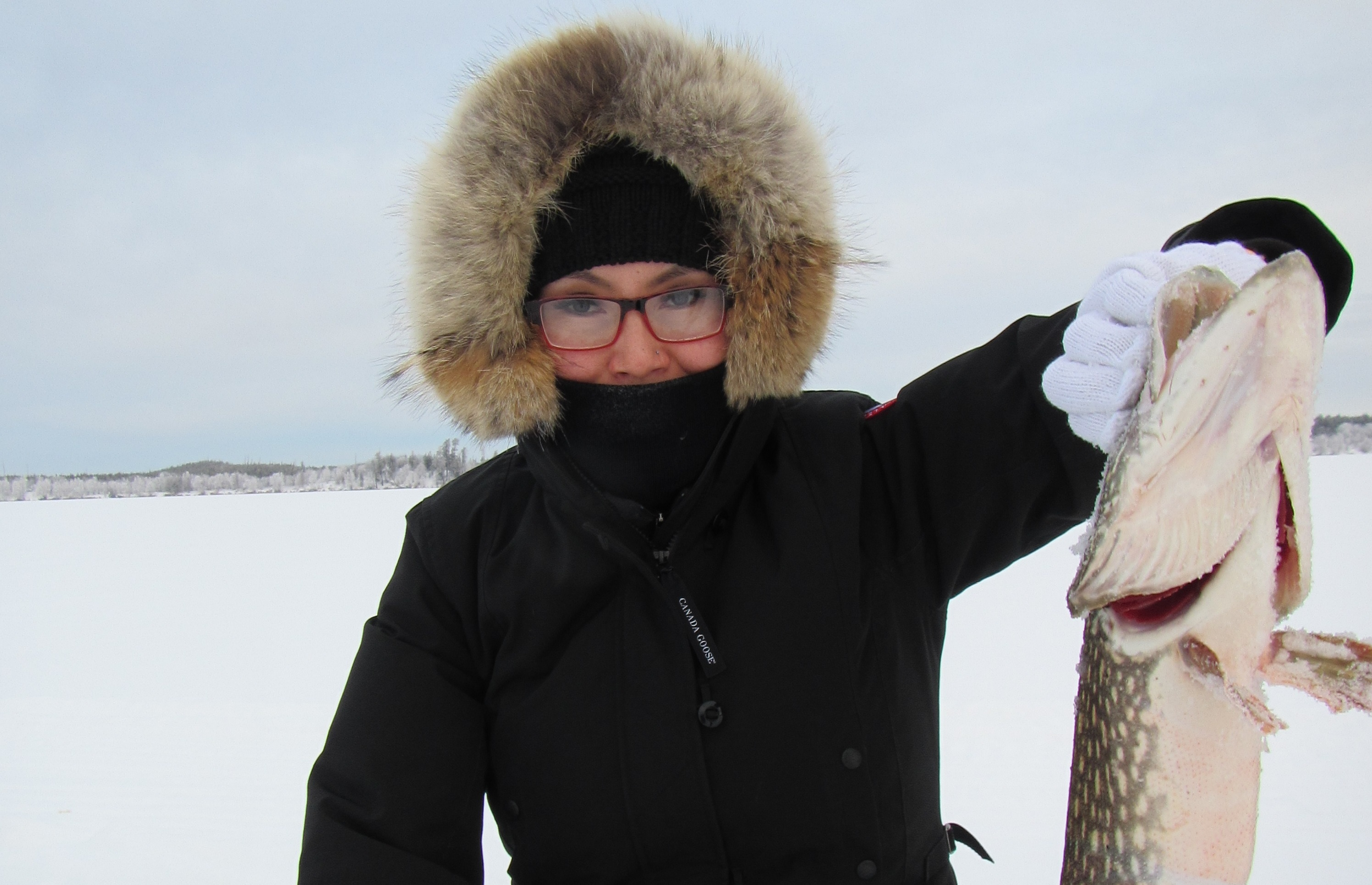 Cora Lemaigre catches a fish in a Dene culture class as part of her bachelor of education degree. (Submitted by Cora Lemaigre)