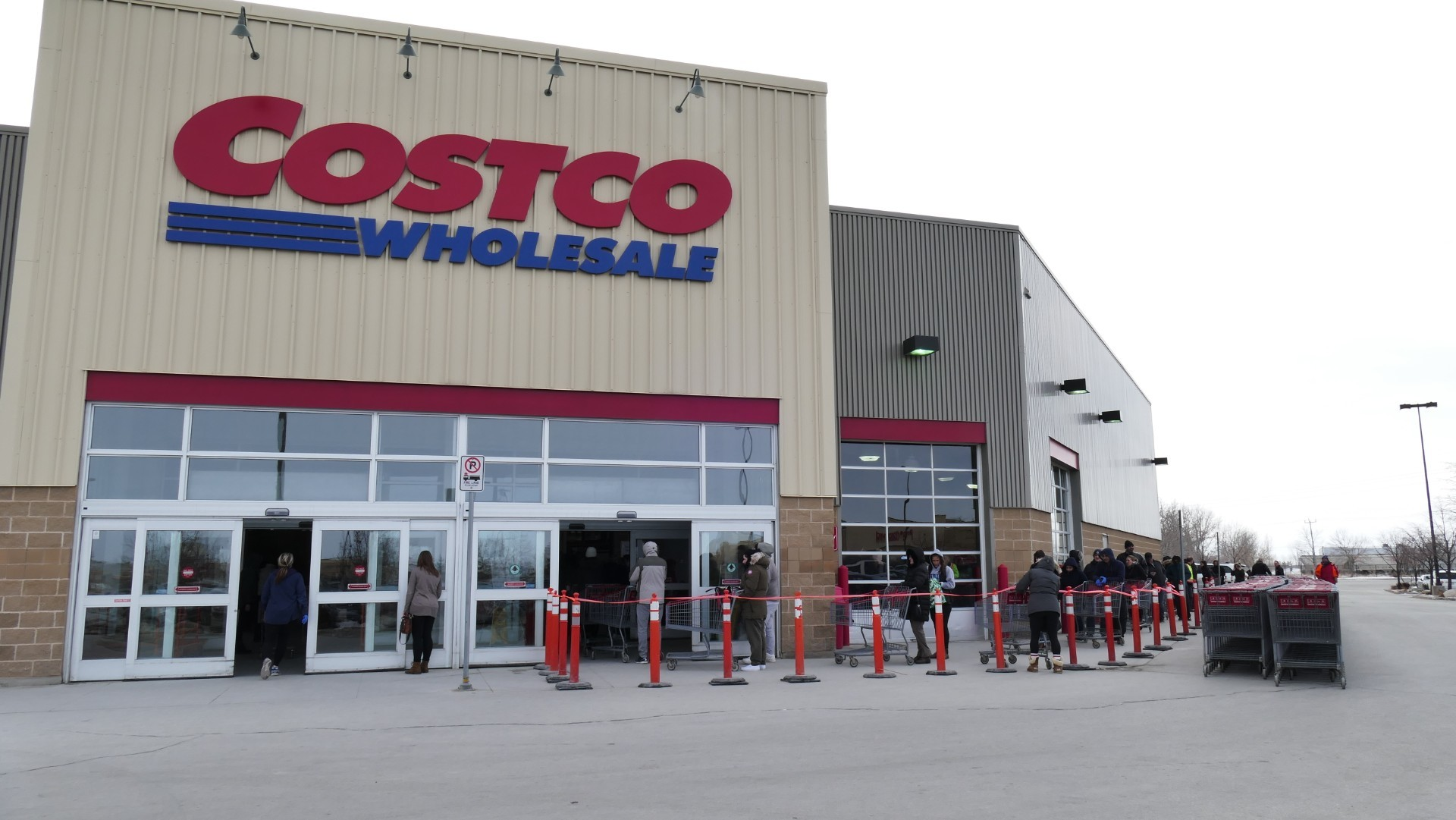 Customers wait in a lineup to go inside Costco on Kenaston Boulevard. (Darin Morash/CBC)