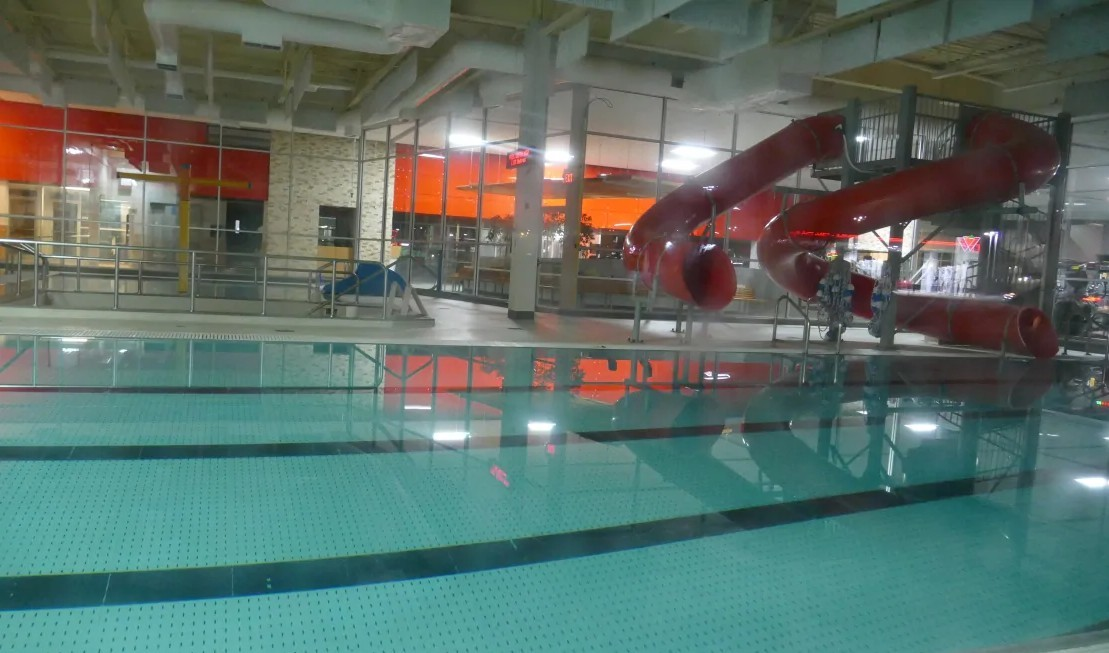 Like many other places, the indoor swimming pool at the YMCA-YWCA's West Portage branch in Winnipeg also went silent for many months. It has since reopened, at limited capacity. (Tyson Koschik/CBC)