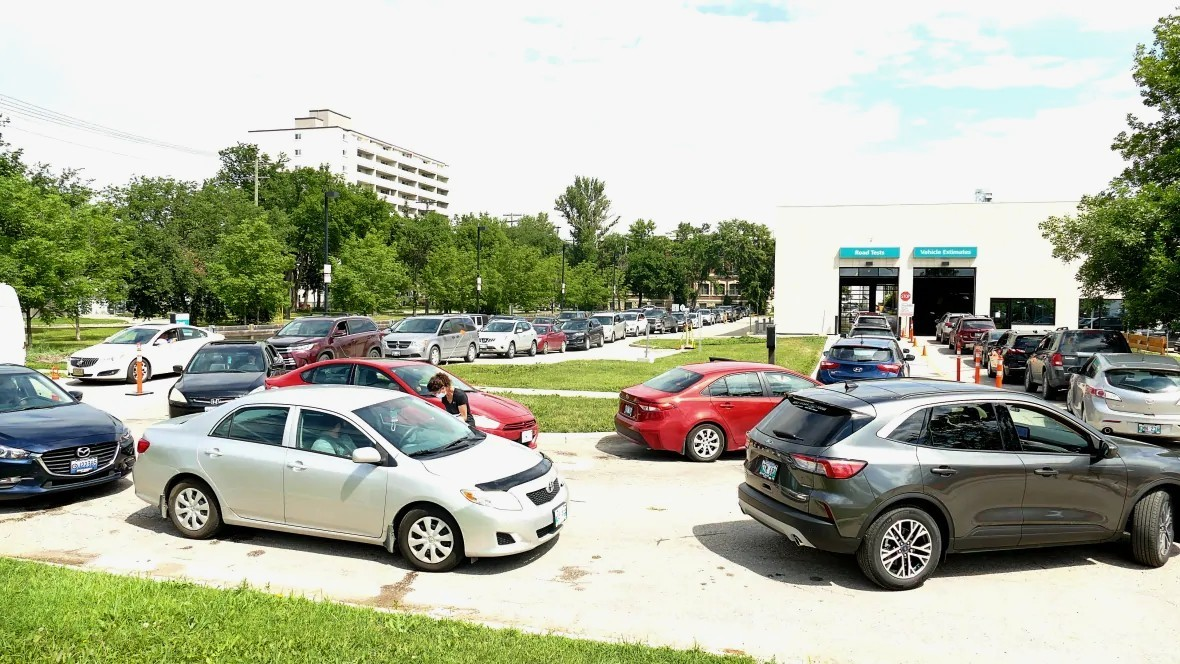 Long lines were a common site at drive-thru COVID-19 testing sites in Winnipeg in July. (Tyson Koschik/CBC)