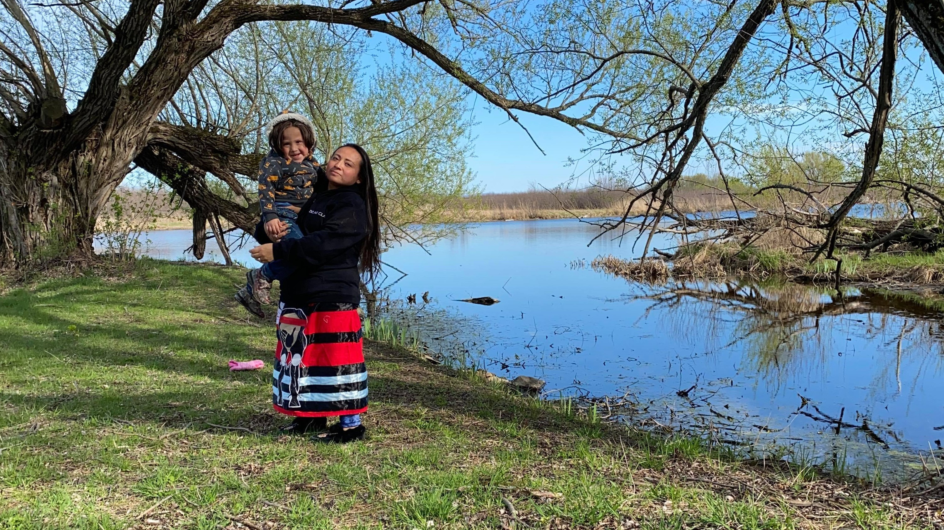 Chrissy Jacobs and her three-year-old son Thikaweraien at the land back language camp. (Submitted by Chrissy Jacobs)