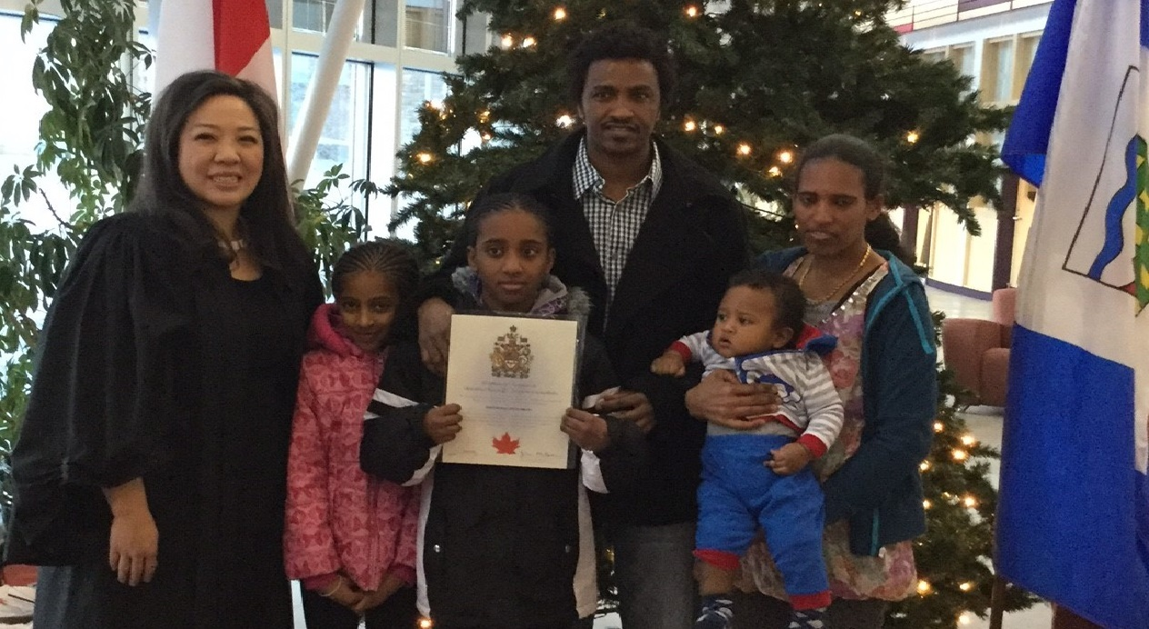 The family celebrates Tesfamichael Abraha's Canadian citizenship in 2016. (Submitted by Art Durkee)