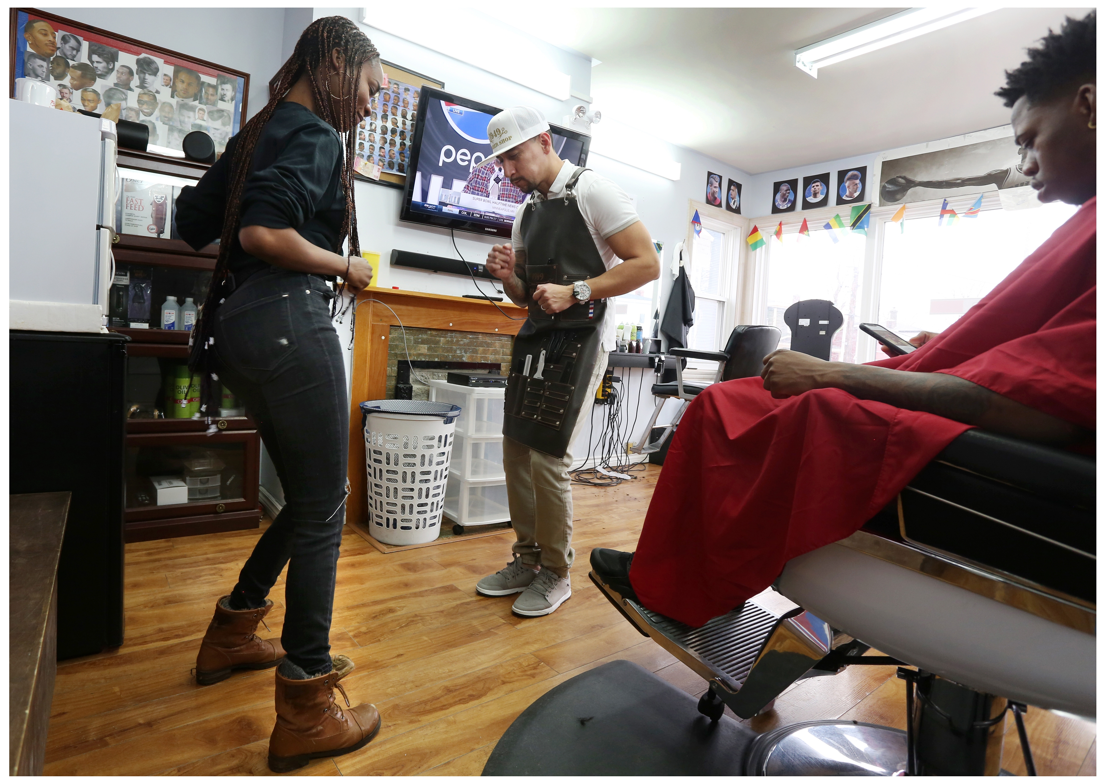 A little music lightens the mood at the barbershop. (Paul Daly)