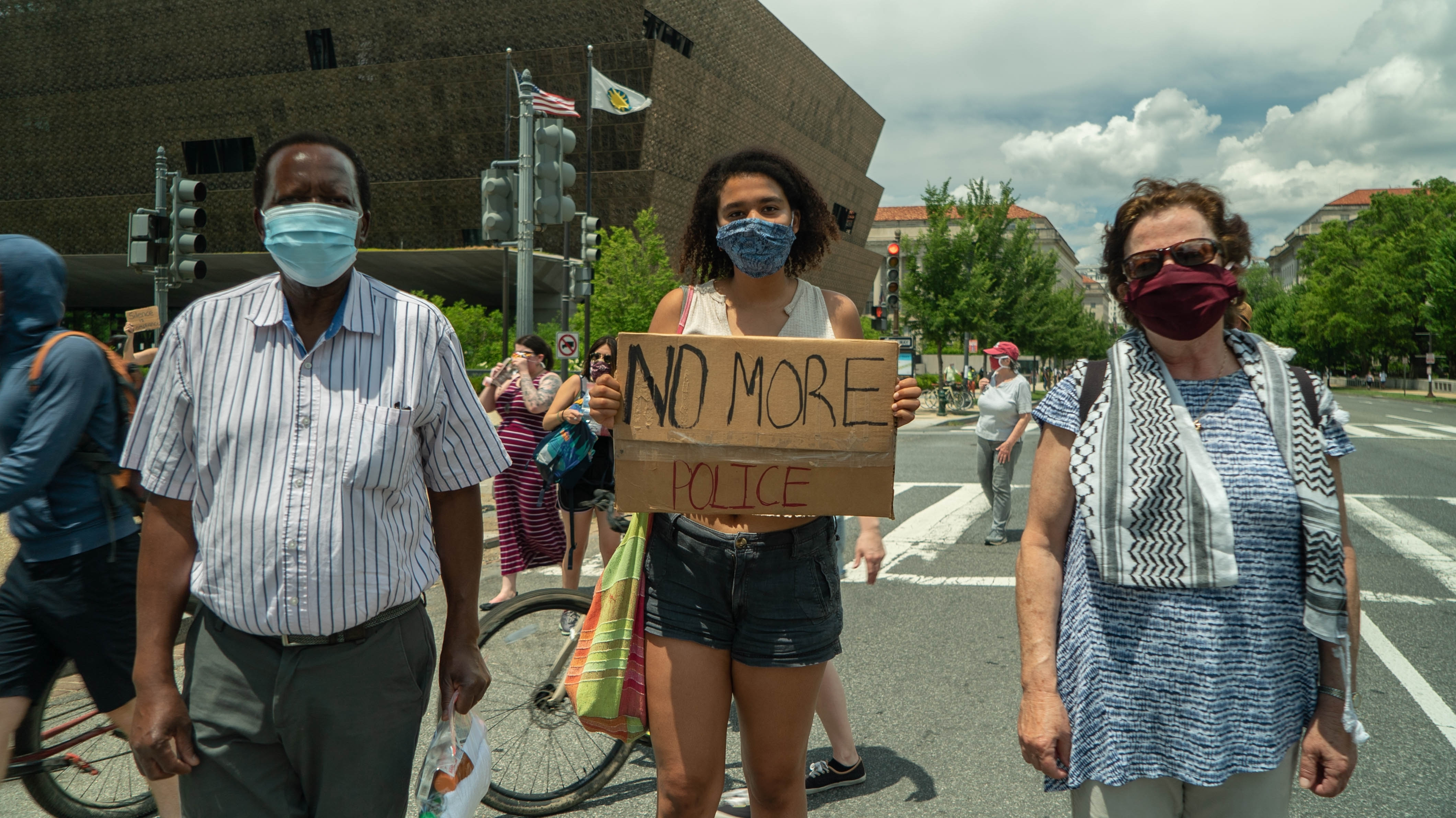 Handel Mlilo, his wife, Nadine Sahyoun and their daughter, Miranda, at the D.C. protest. (Jean-François Bisson/CBC)