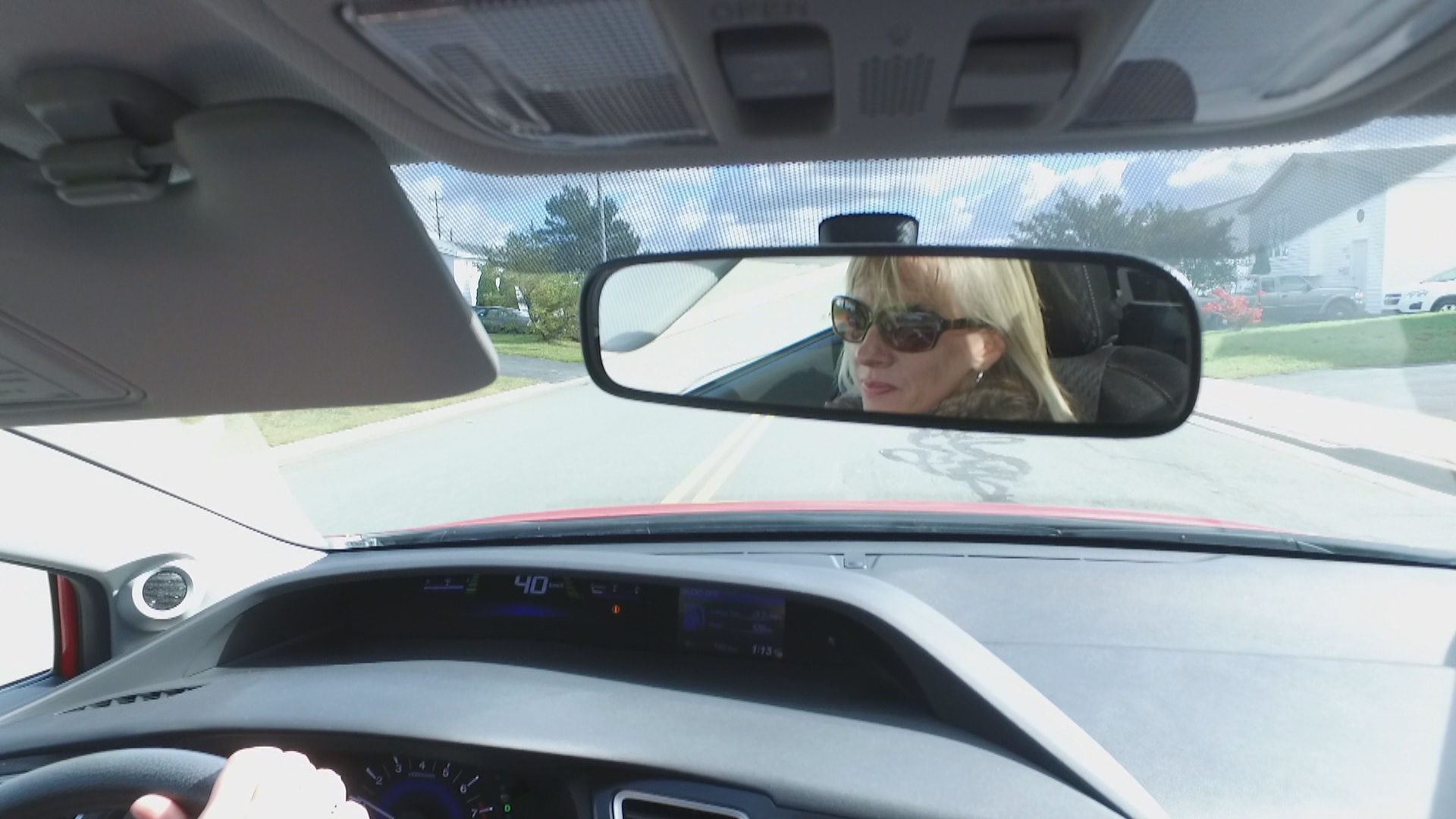 Debbie Maloney loves driving her sporty, red two-door car. (Gary Quigley/CBC)