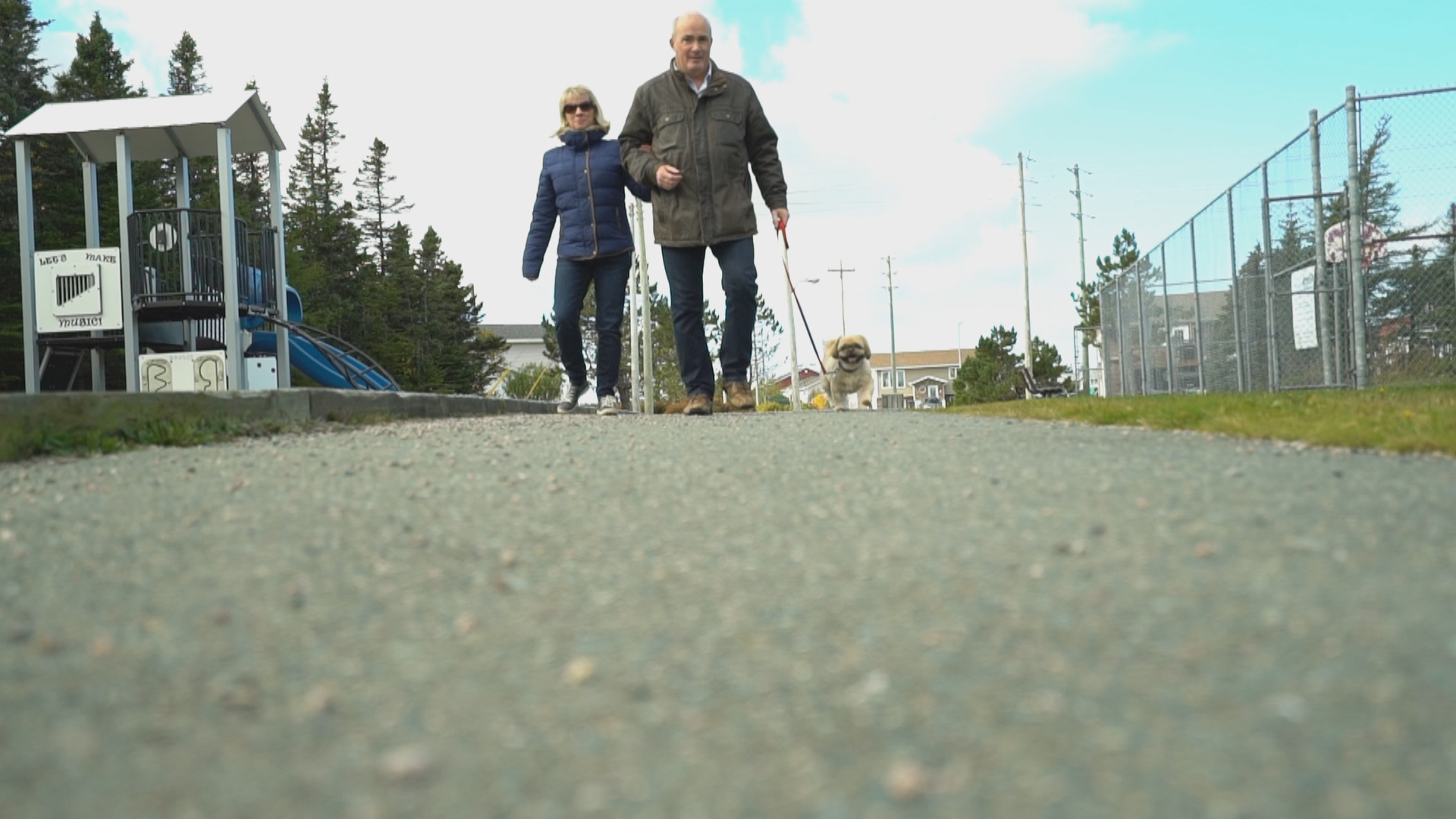 Now, Debbie Maloney enjoys going for walks with her partner Glenn Parsons and their dog Finnigan at a park near their home in Mount Pearl. (Sherry Vivian/CBC)