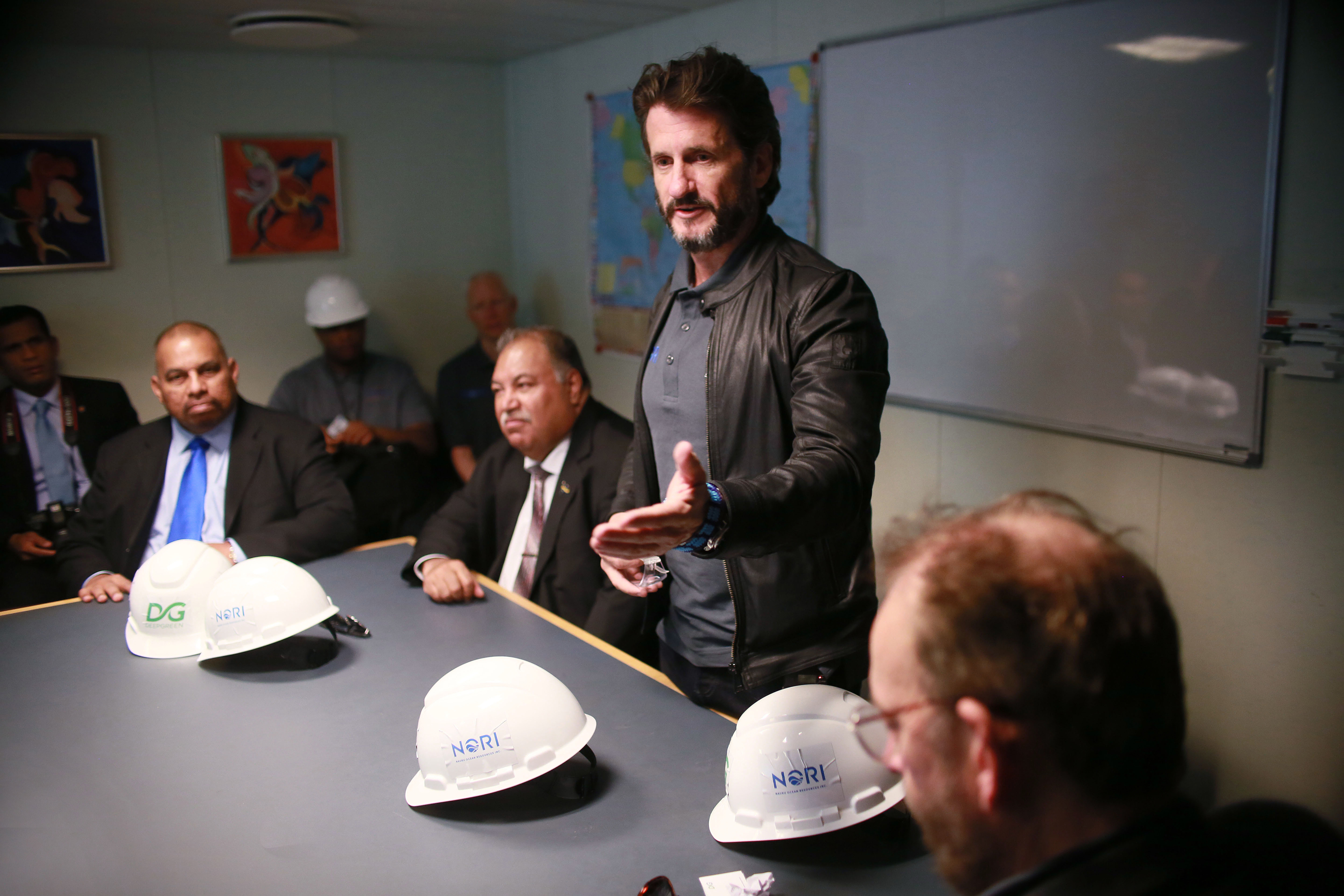 DeepGreen CEO Gerard Barron, standing, speaks to Nauru President Baron Waqa, to his immediate right, and others in Nauru in April 2018. DeepGreen has a partnership with the small Pacific country that enables the company to hunt for manganese nodules in the Clarion-Clipperton Fracture Zone. (Sandy Huffaker/Associated Press)