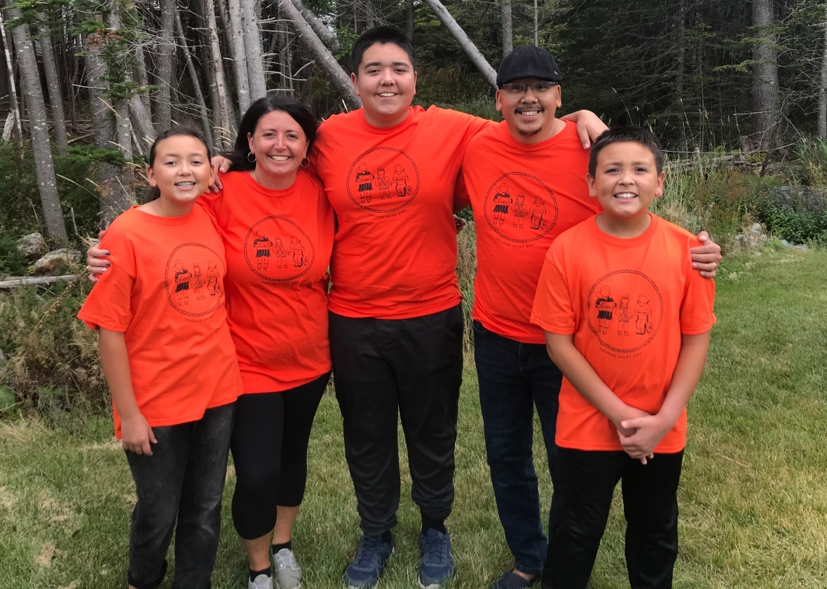 Dakoda Dicker, left, drew the design for this year's Orange Shirt Day for a contest with First Light. She and her family moved from Nain to Portugal Cove-St. Philip's in 2018. (Submitted by Lori Dicker)