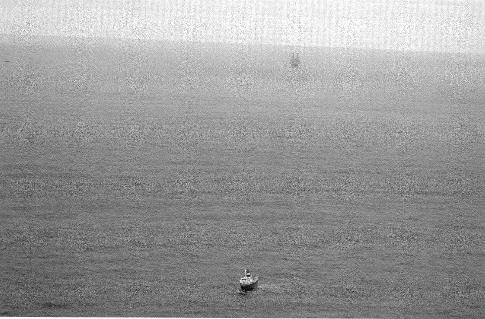 The Lyubov Orlova drifts in the Atlantic Ocean with the Hibernia oil platform in view. (Transport Canada)