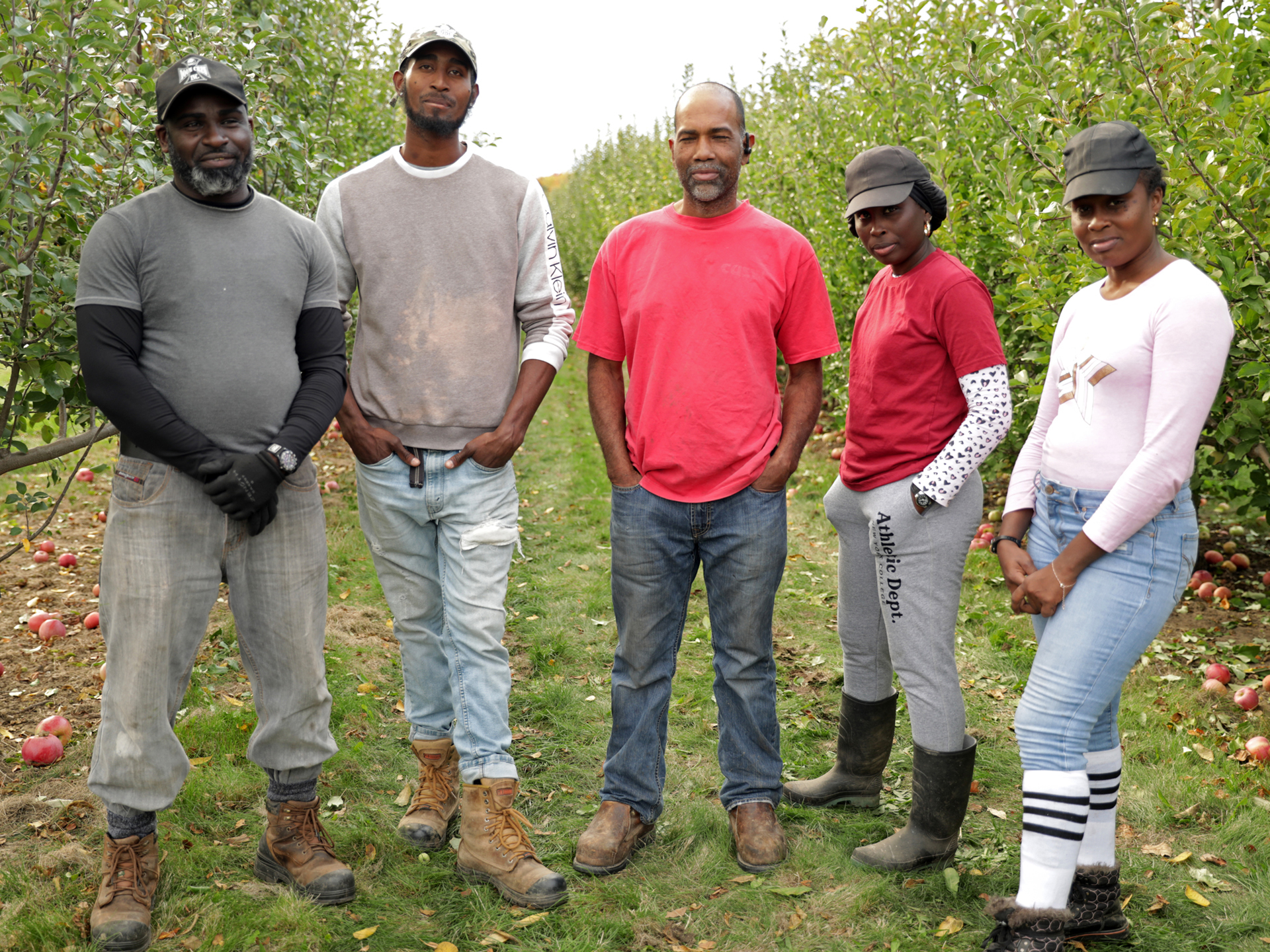 Felix Ragoo (centre) has been coming to work at Schuyler Farms for 21 seasons on temporary work permits. His brother-in-law Kerwin Anderson, far left, and son Deon Ragoo as well as daughters Shelly Ragoo,far right, and Sheerine King are with him this year. (Virginia Smart/CBC)