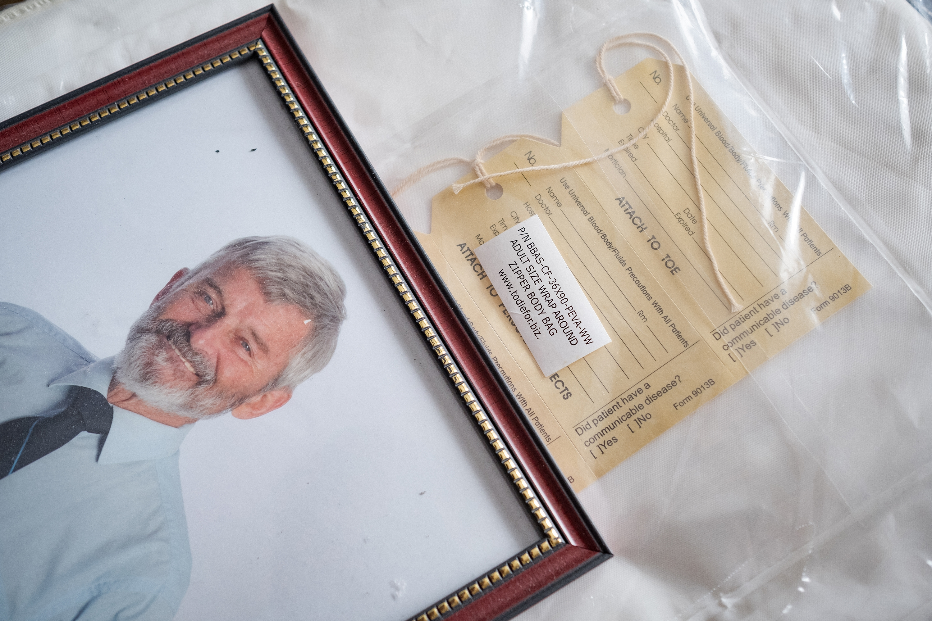 A photo of Edward Farrar, alongside the body bag that Mary has purchased for him. (Evan Mitsui/CBC)