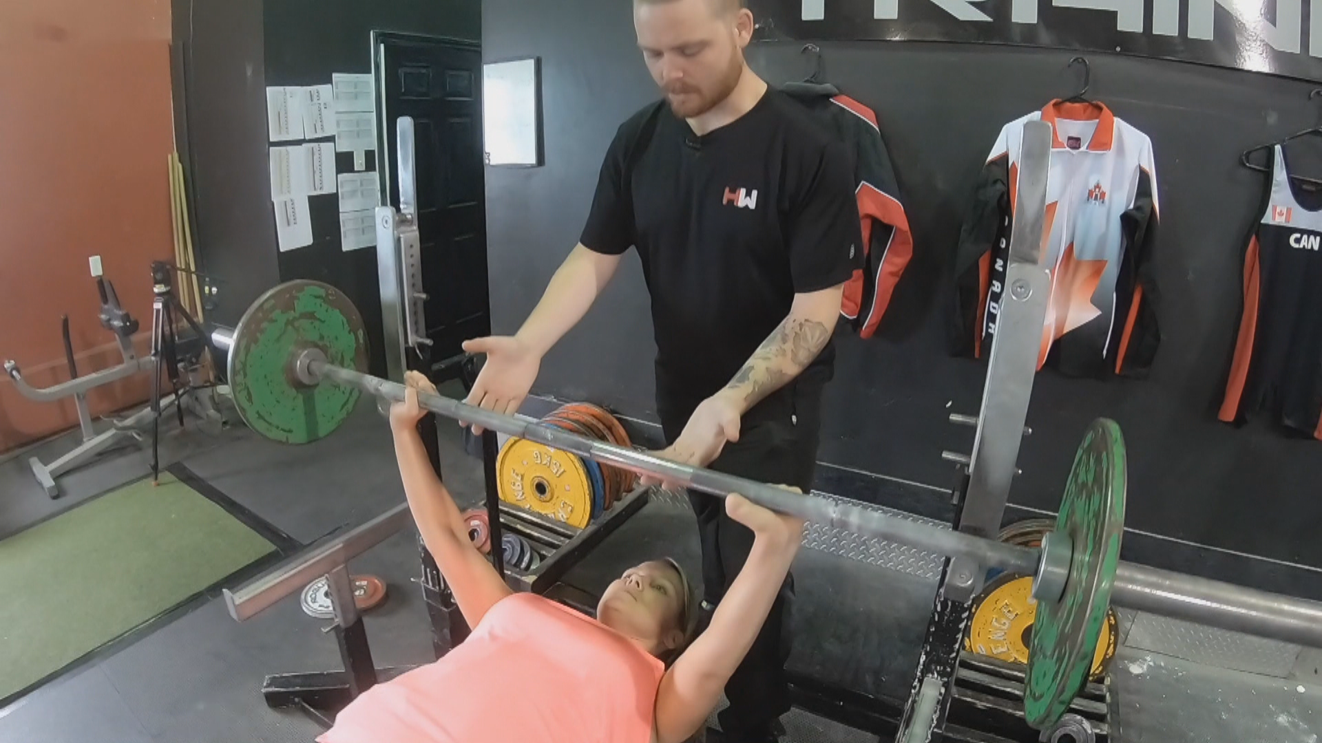 In order to do a chest press, Elaine Dodge-Lynch has to balance the bar perfectly. (Sherry Vivian/CBC)