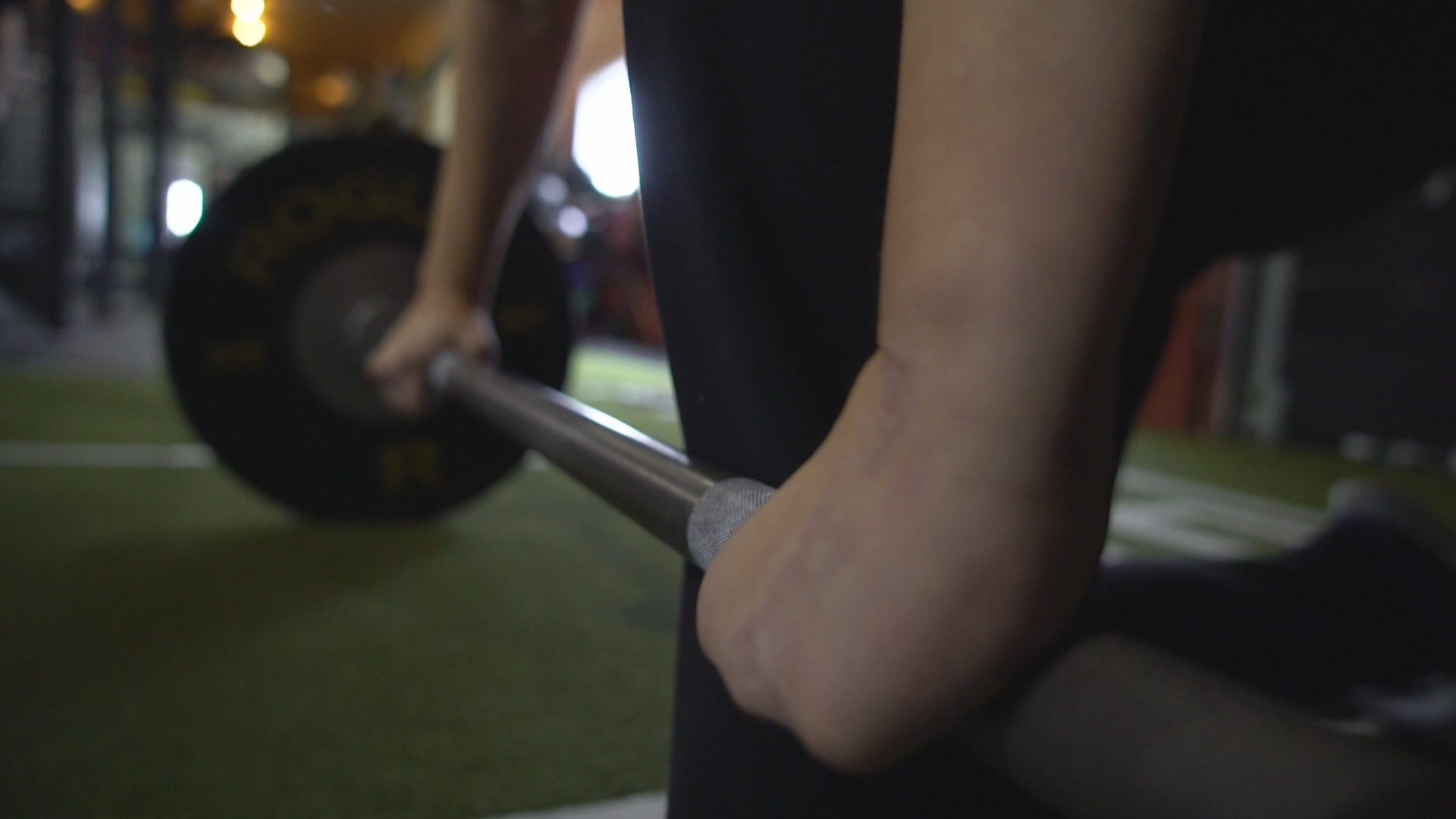 The added gym equipment allows Elaine Dodge-Lynch to take her hands out of the equation for deadlifts. (Gary Quigley/CBC)