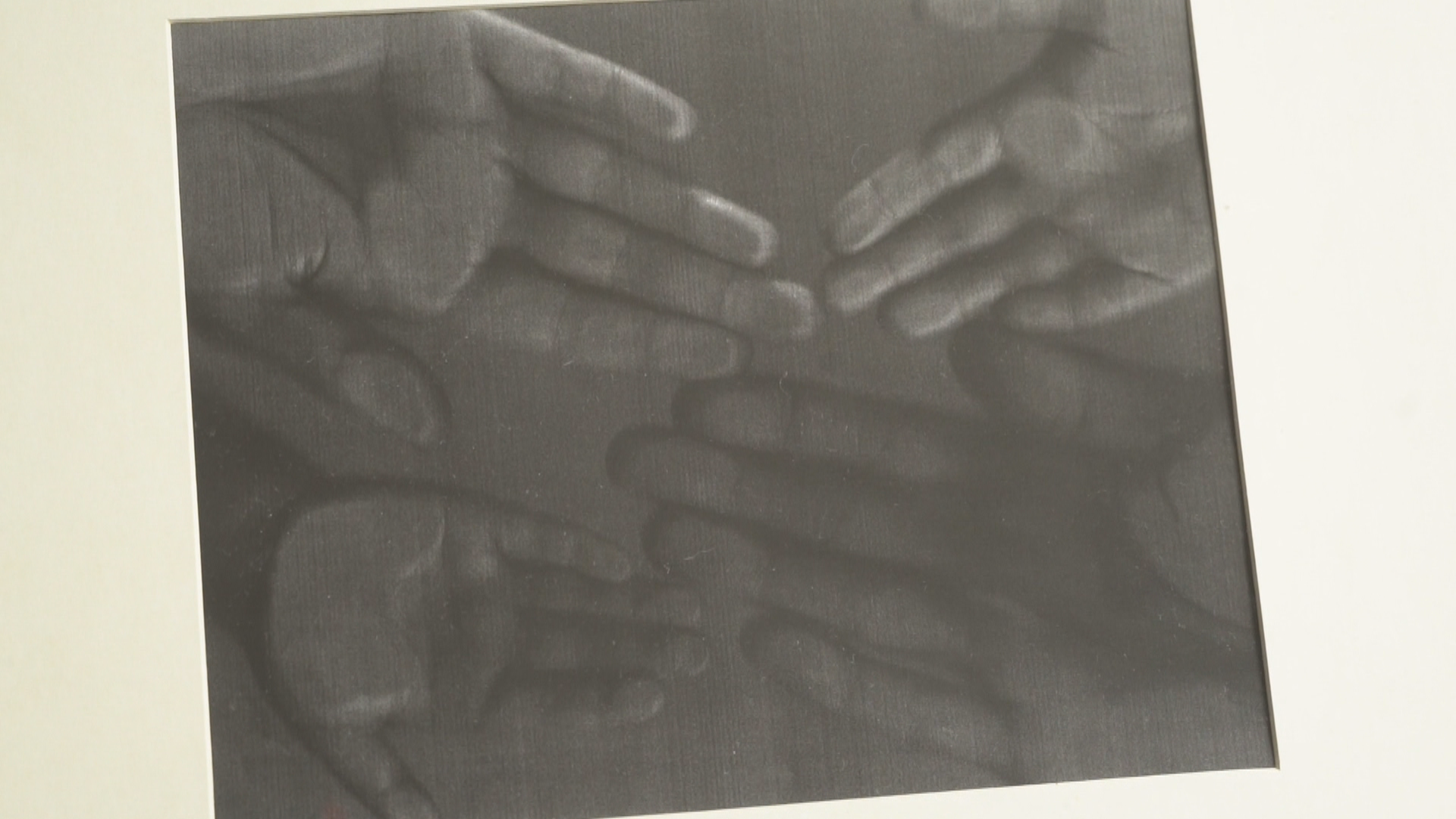 A photocopy of the family's hand prints hangs in their hallway. (Gary Quigley/CBC)