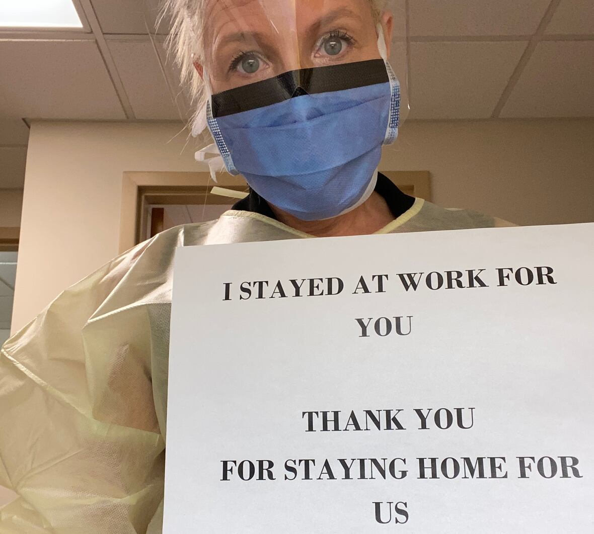 The spouse of an occupational health nurse says front-line workers are putting patients first, so the public should do its best to prevent them from getting sick. (Submitted by Chris Marshall)