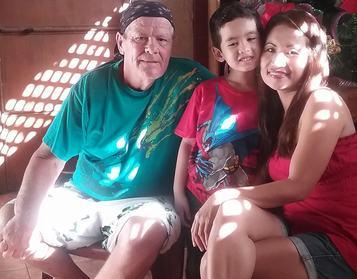 Luzie and Barry Gammon and their son, JJ, at their home in the Philippines. (Luzie Gammon)
