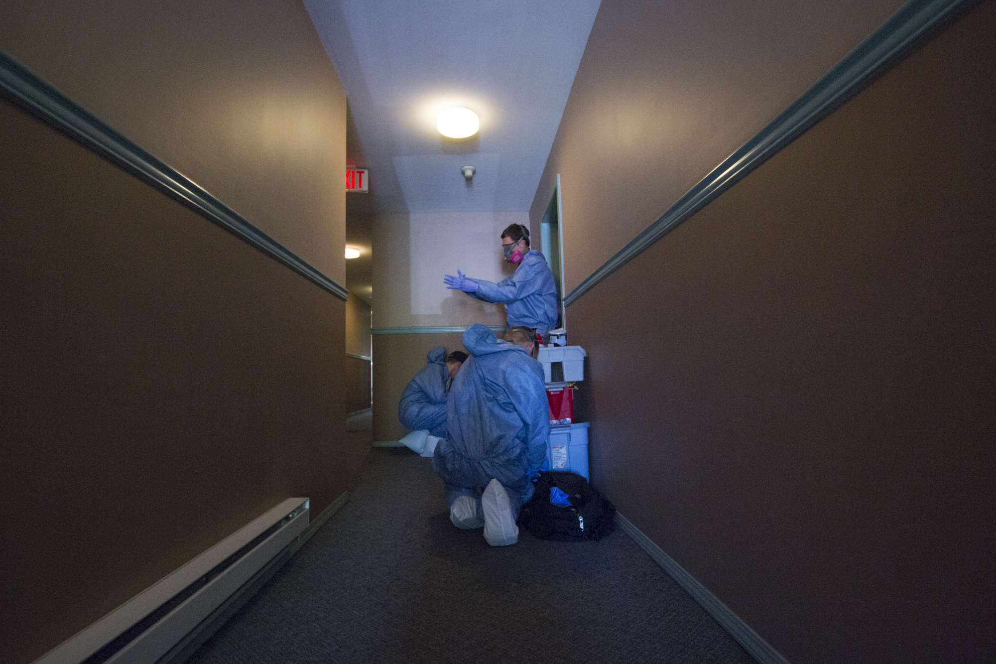 Kreklau and his team get suited up before going into the apartment to avoid cross-contamination. (Tina Lovgreen/CBC)