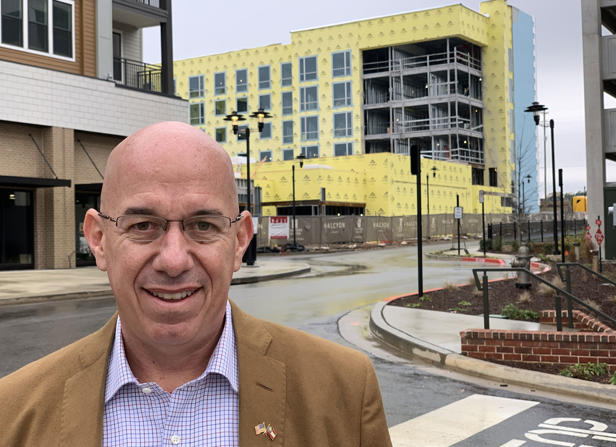 Carter Patterson, seen in one of Forsyth's new construction developments, says the region's new diversity is a great asset. (Alexander Panetta/CBC)
