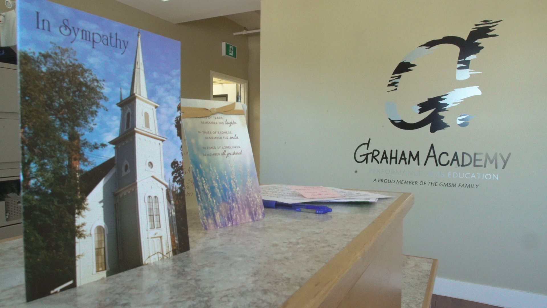 Sympathy cards were placed on the front desk in the lobby of the Graham Academy. (Jen White/CBC)