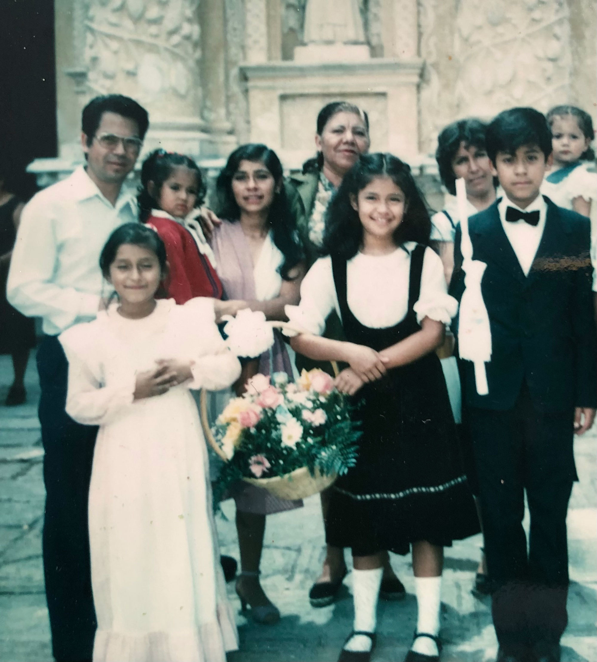 Dr. Orencio Sosa, left, with his wife, Consuelo, holding their youngest daughter with their three other children in the front row before his disappearance in 1983. (Submitted by Consuelo Pérez)