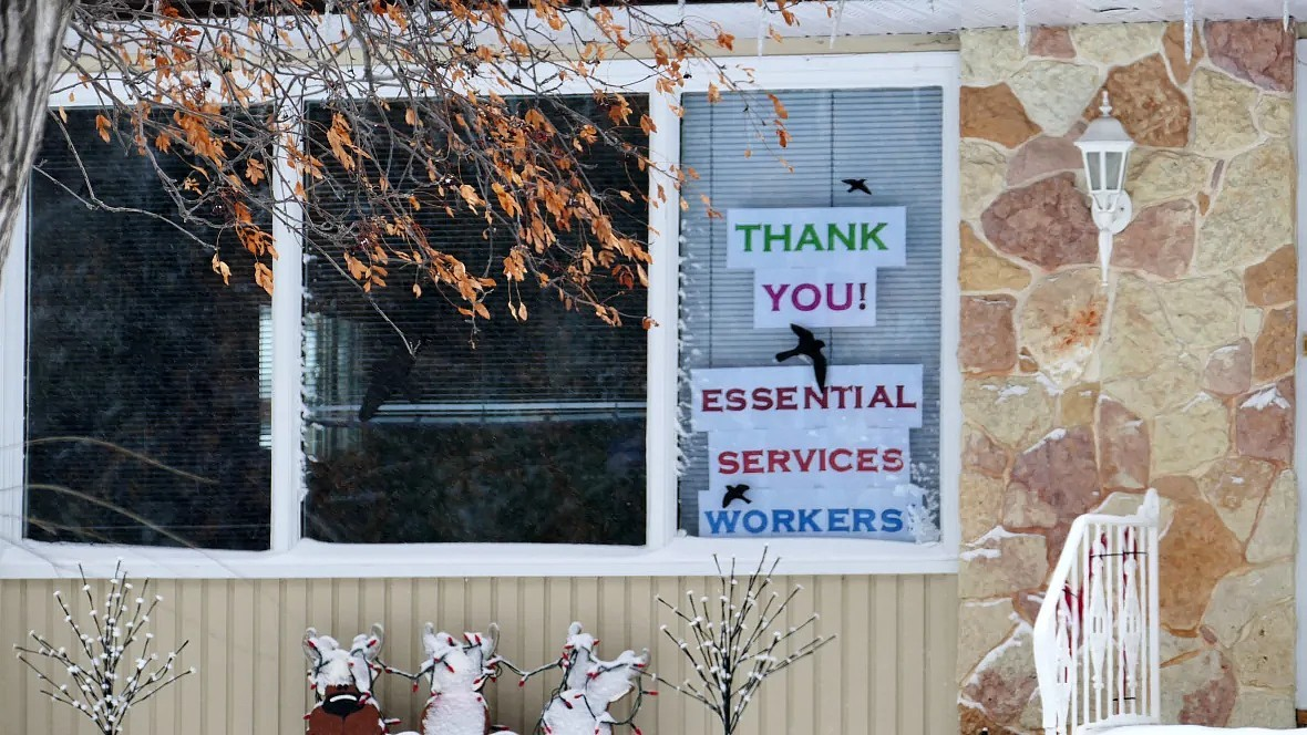 A sign in St. James neighbourhood in Winnipeg shows support for essential services workers. (Tyson Koschik/CBC)