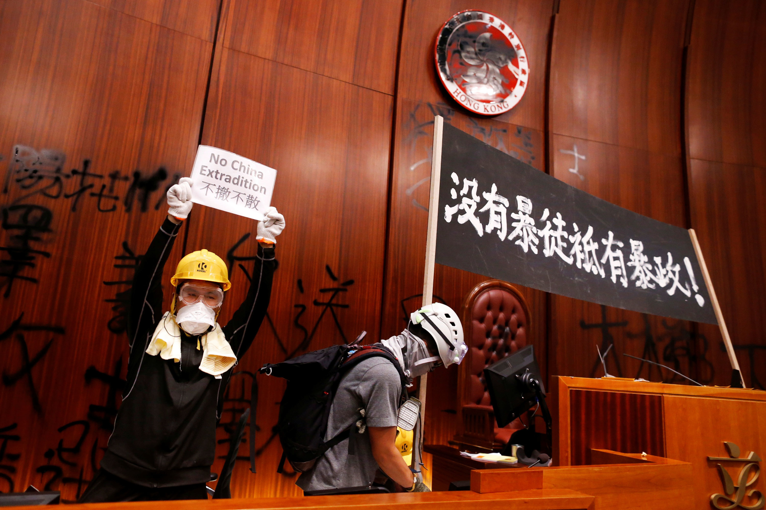 After the protesters breached the Hong Kong legislature on July 1, they defaced the inside of the building with slogans. (Stringer/Reuters)