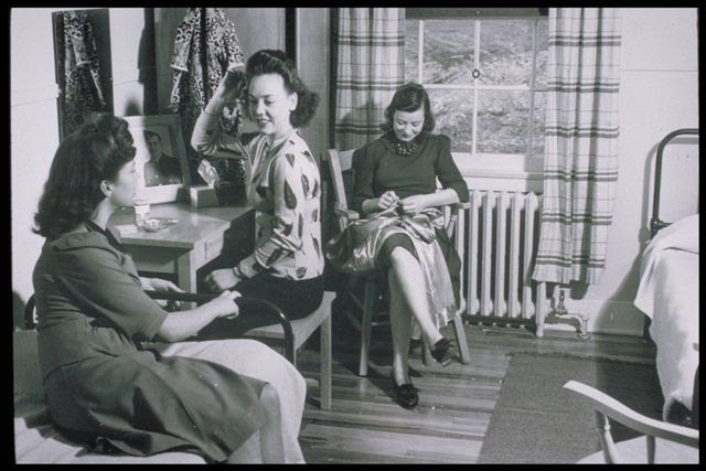 A slide from a recruitment presentation shown to young Newfoundland women, showing mill girls relaxing in their residence. Photo: Hespeler Heritage Centre.