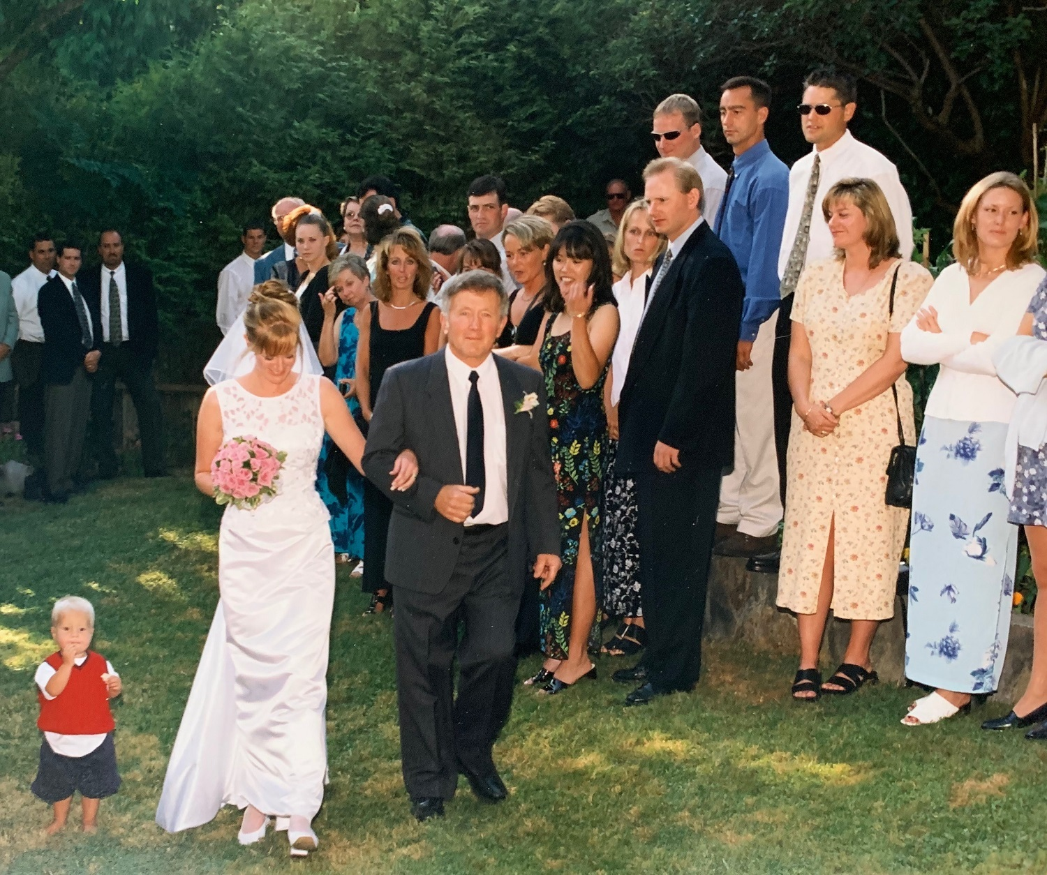Megan Frederick walks down the aisle arm-in-arm with her father, Michael Smith, on her wedding day. (Submitted by family)