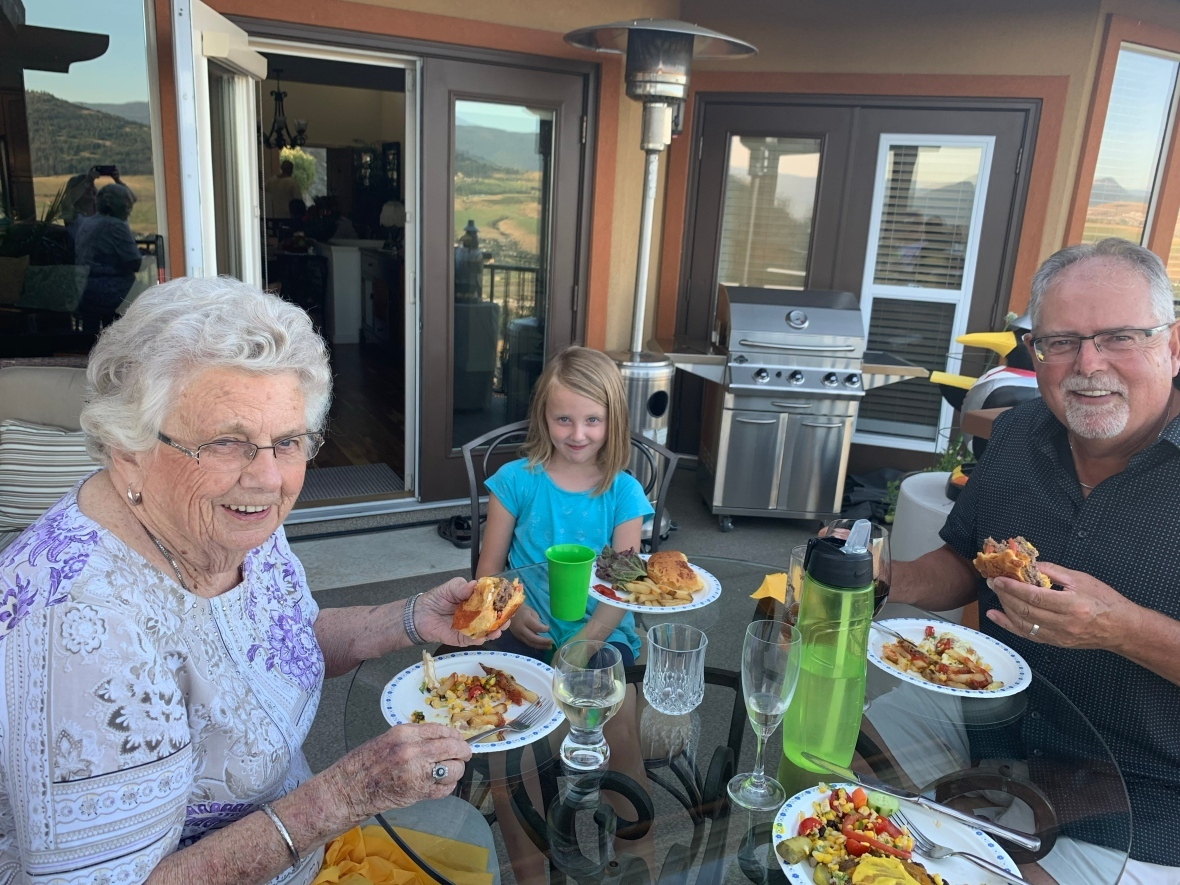 Dodie Anderson shares a meal and a smile with her son Phil and granddaughter on her 92nd birthday. (Submitted by Susan Harris)