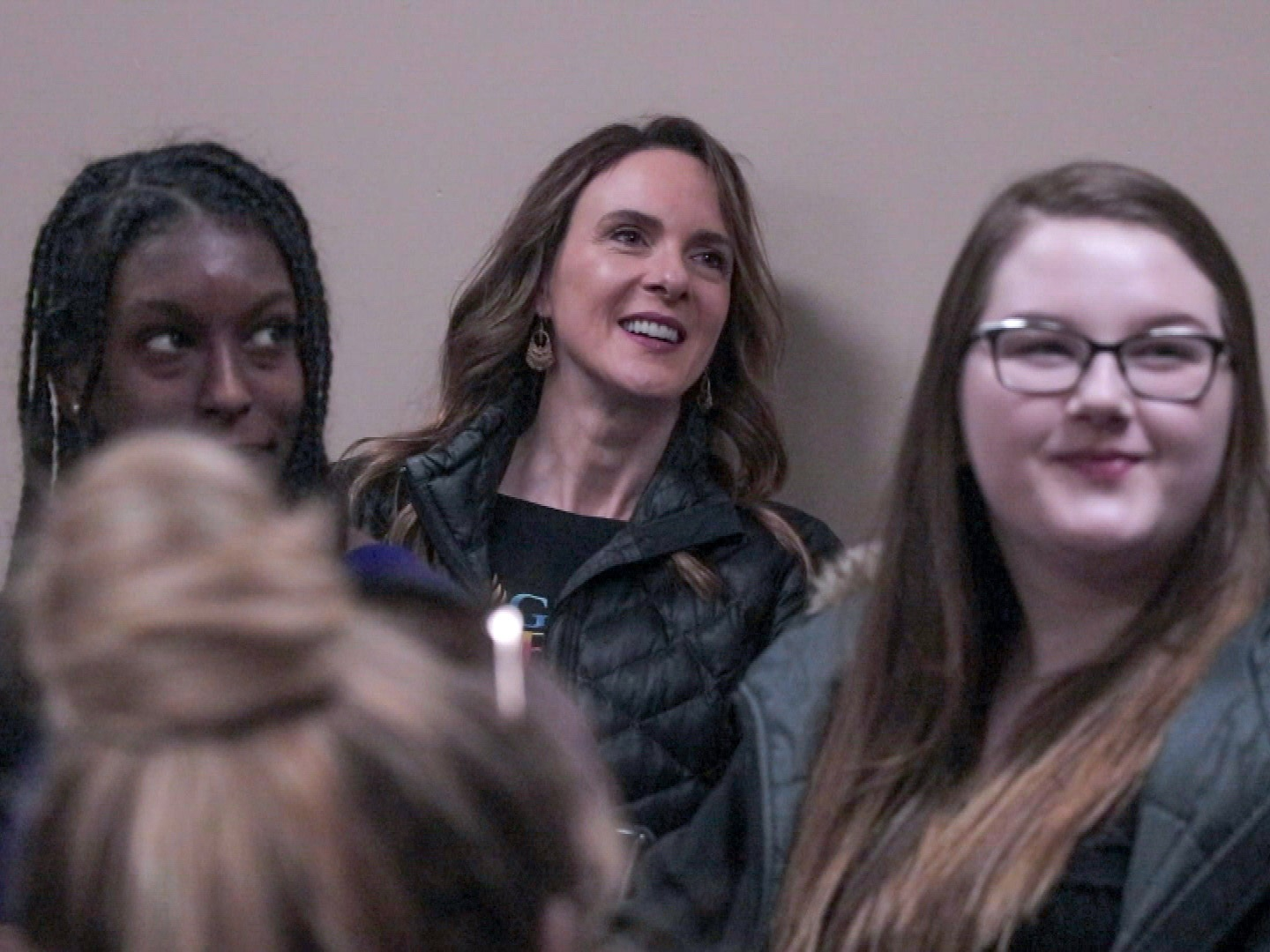 Former teacher Jenny Kierstead, centre, is the founder of Girl on Fire. (Steve Berry/CBC)
