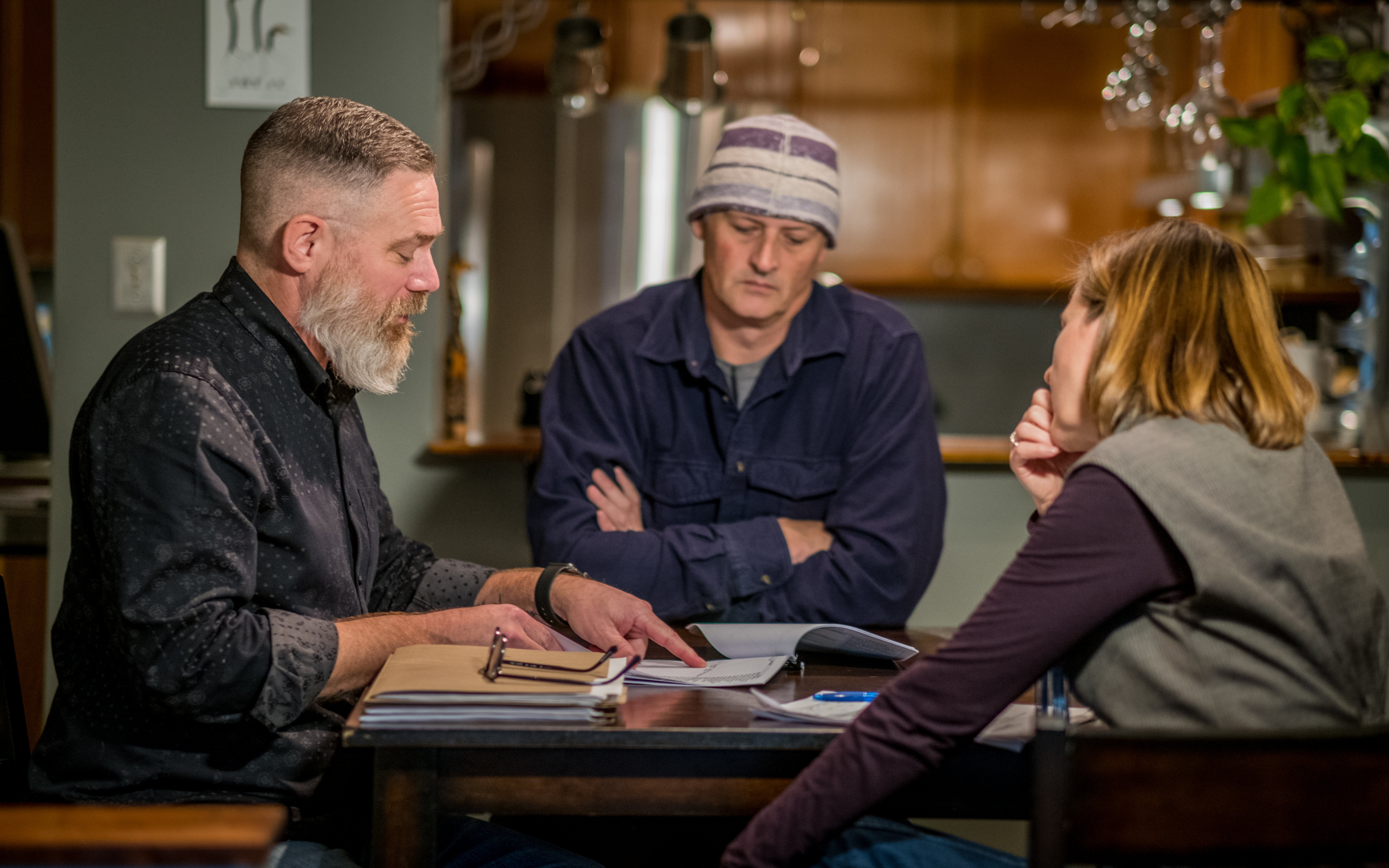 Podcast host Julie Ireton, right, sits down with Peter Hamer, left, and Marc Leach, centre. (Michel Aspirot/CBC)