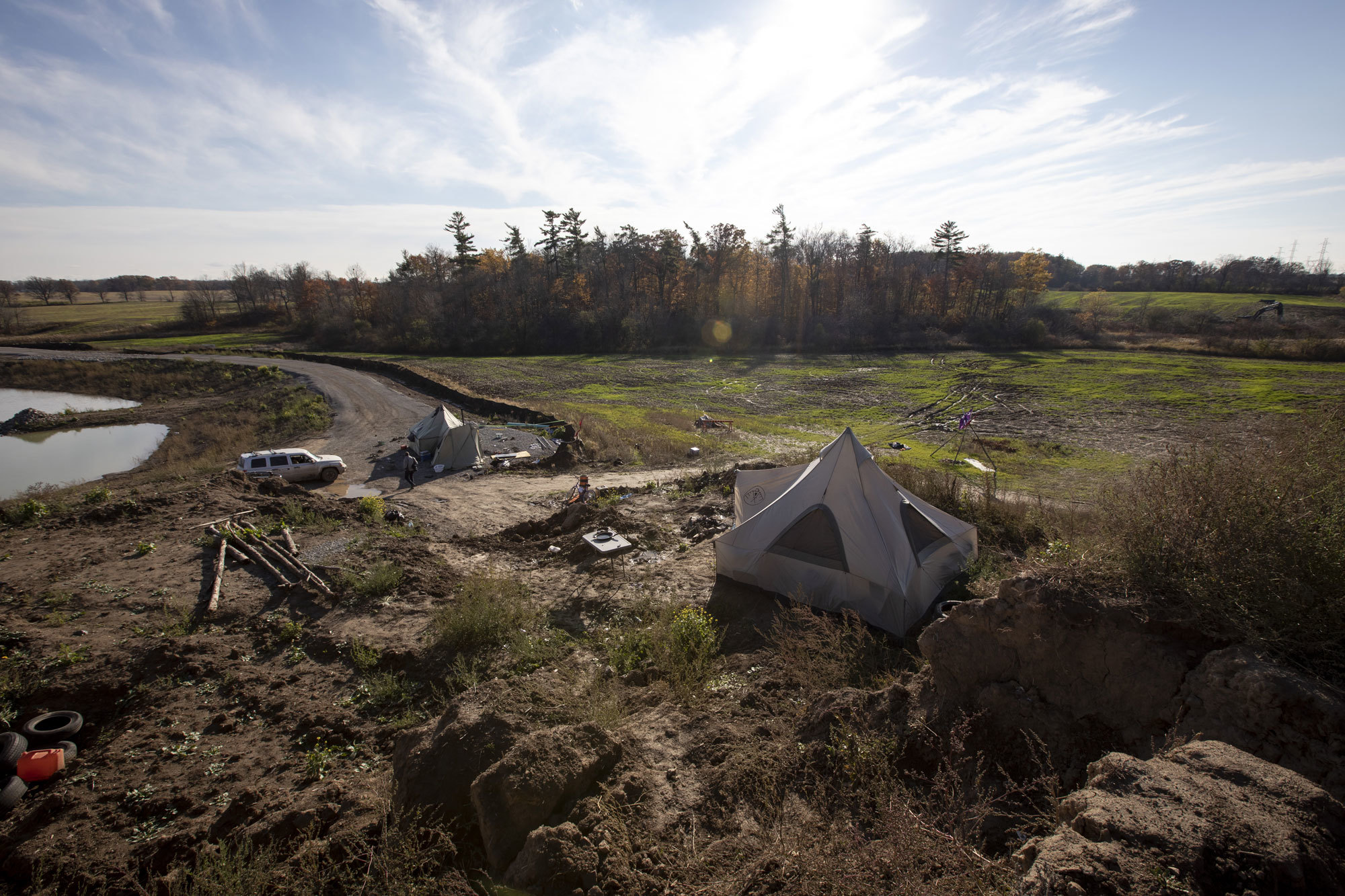 A view of some of the tents that form the 1492 Land Back Lane camp on the planned McKenzie Meadows subdivision. (Evan Mitsui/CBC)
