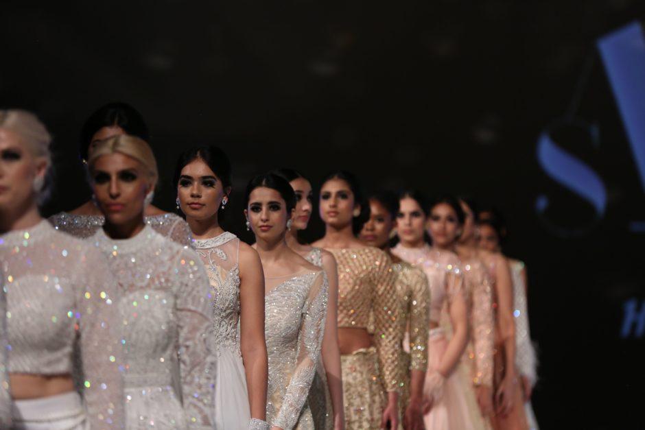 Models walk the runway at the inaugural Vancouver South Asian Fashion Week in 2018.