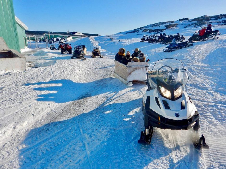 Snowmobiles and komatiks outside the Amos Comenius School in Hopedale, Labrador. (Kellie Walsh)