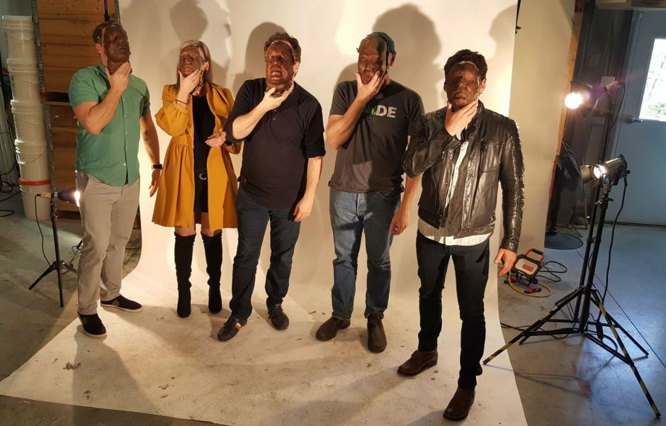 Jeremy Eaton, Krissy Holmes, Mark Critch, Todd Perrin and Allan Hawco hold masks of their faces. (Ian Gillies)