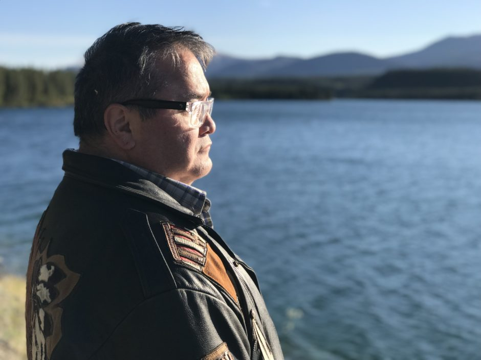 Gord Loverin looks out over a lake in Whitehorse.