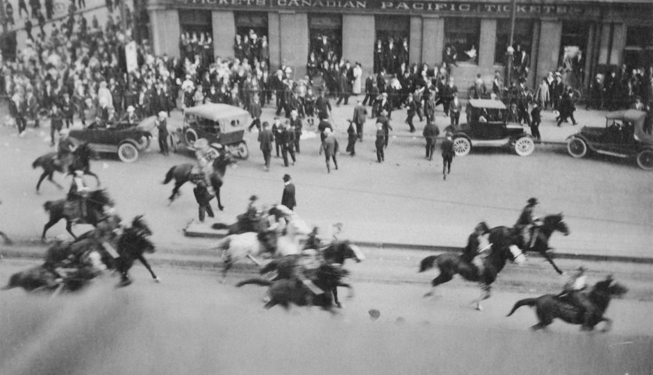 Special constables rush on horseback through a crowd at the corner of Portage Avenue and Main Street on June 10, 1919 (Archives of Manitoba)
