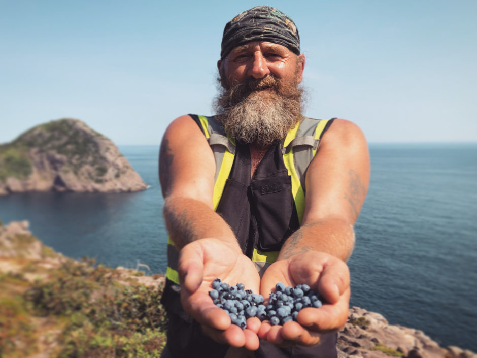 Lorne Rowbottom proudly displays some of the blueberries he has picked.
