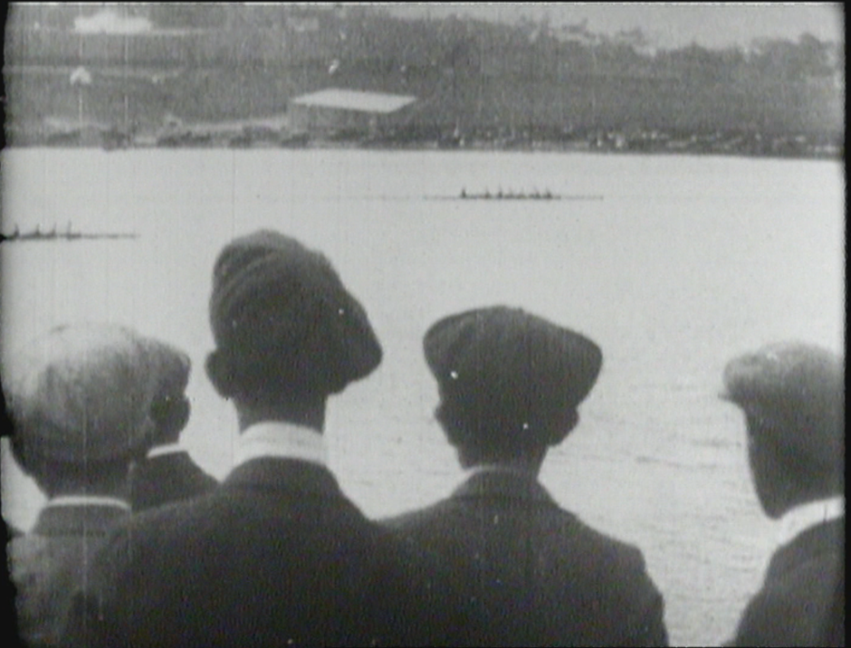 An archival photo from the early 1900s as some young men watch the rowers in the Royal St. John's Regatta at Quidi Vidi Lake.