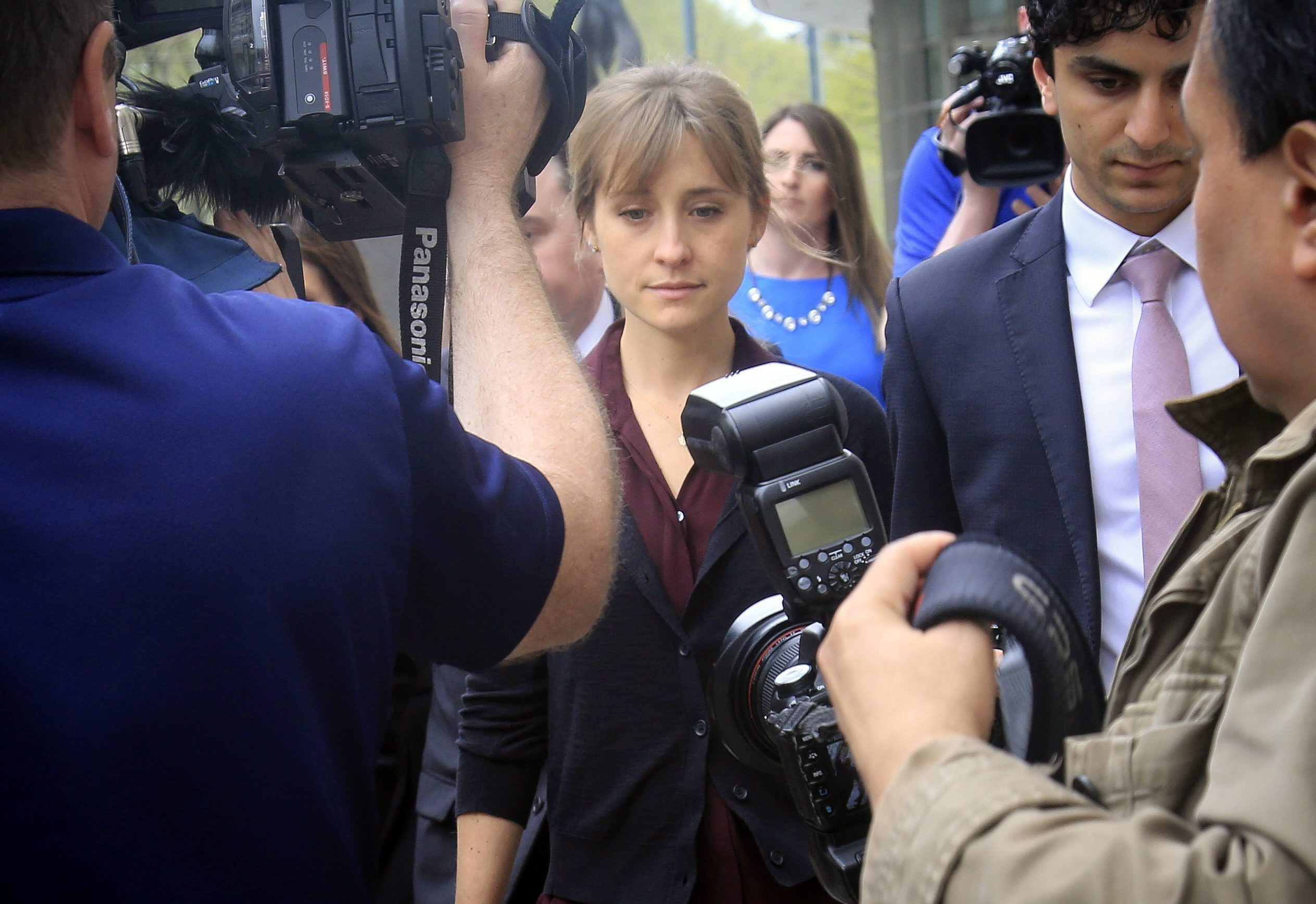Mack leaves after a court hearing in New York City. She and Raniere are charged with coercing women who joined NXIVM into becoming part of a secret sub-group where they were allegedly expected to act as 'slaves' and engage in sex acts. (Bebeto Matthews/Associated Press)