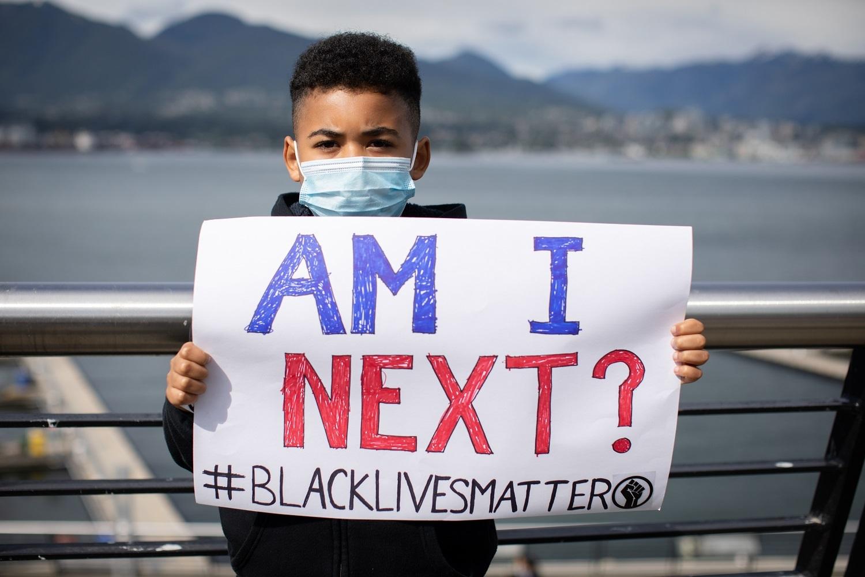 """Racism is not right."" - Madreadi Skinner, 9, protest speaker"