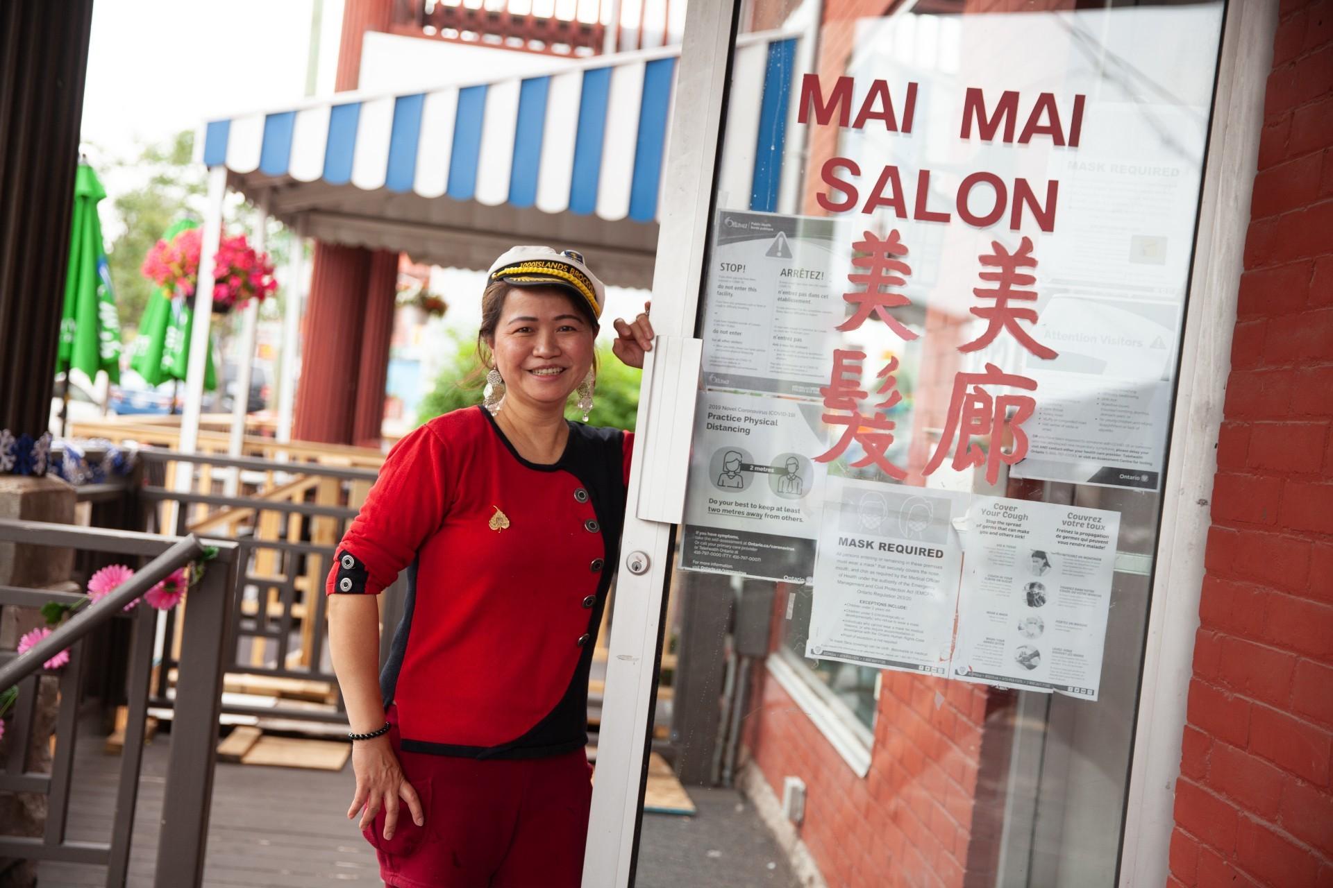 "Mui Manh ""Mai Mai"" Ha outside her newly reopened salon Mai Mai 2. (Fangliang Xu)"