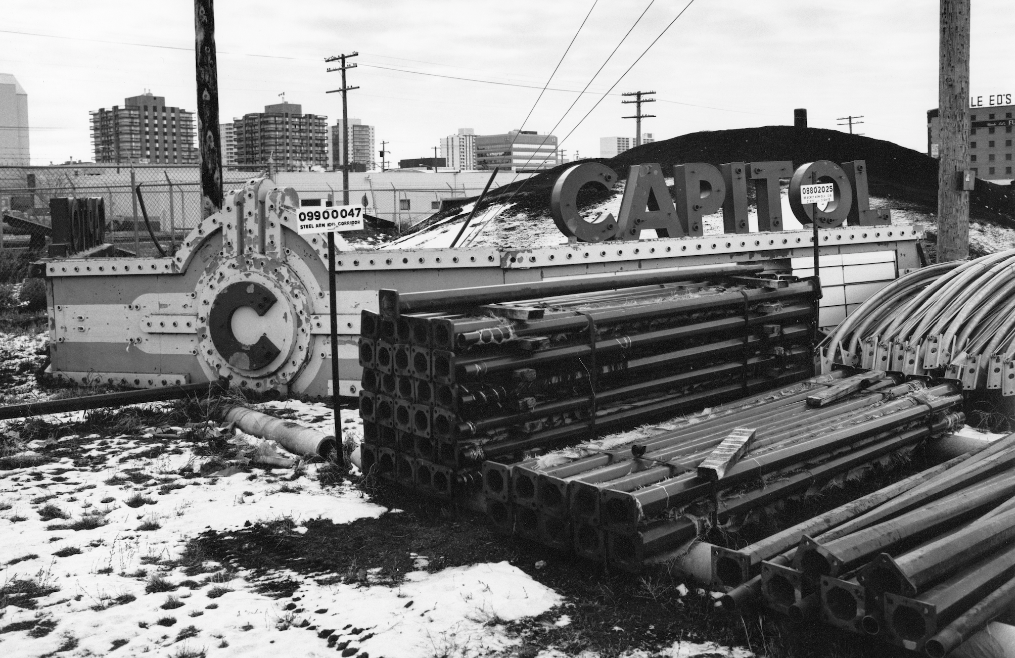 The Capitol marquee was wrestled off the Second Avenue facade and deposited in a city yard in 1979. (Saskatoon Public Library Local History Room; item PH-89-30-42)