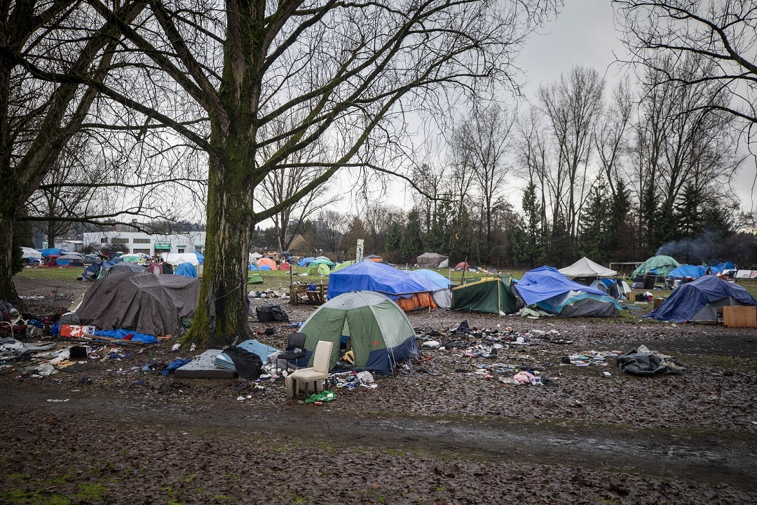 An estimated 200 campers are currently living on top of mud and amid garbage while waiting for other housing options. (Ben Nelms)