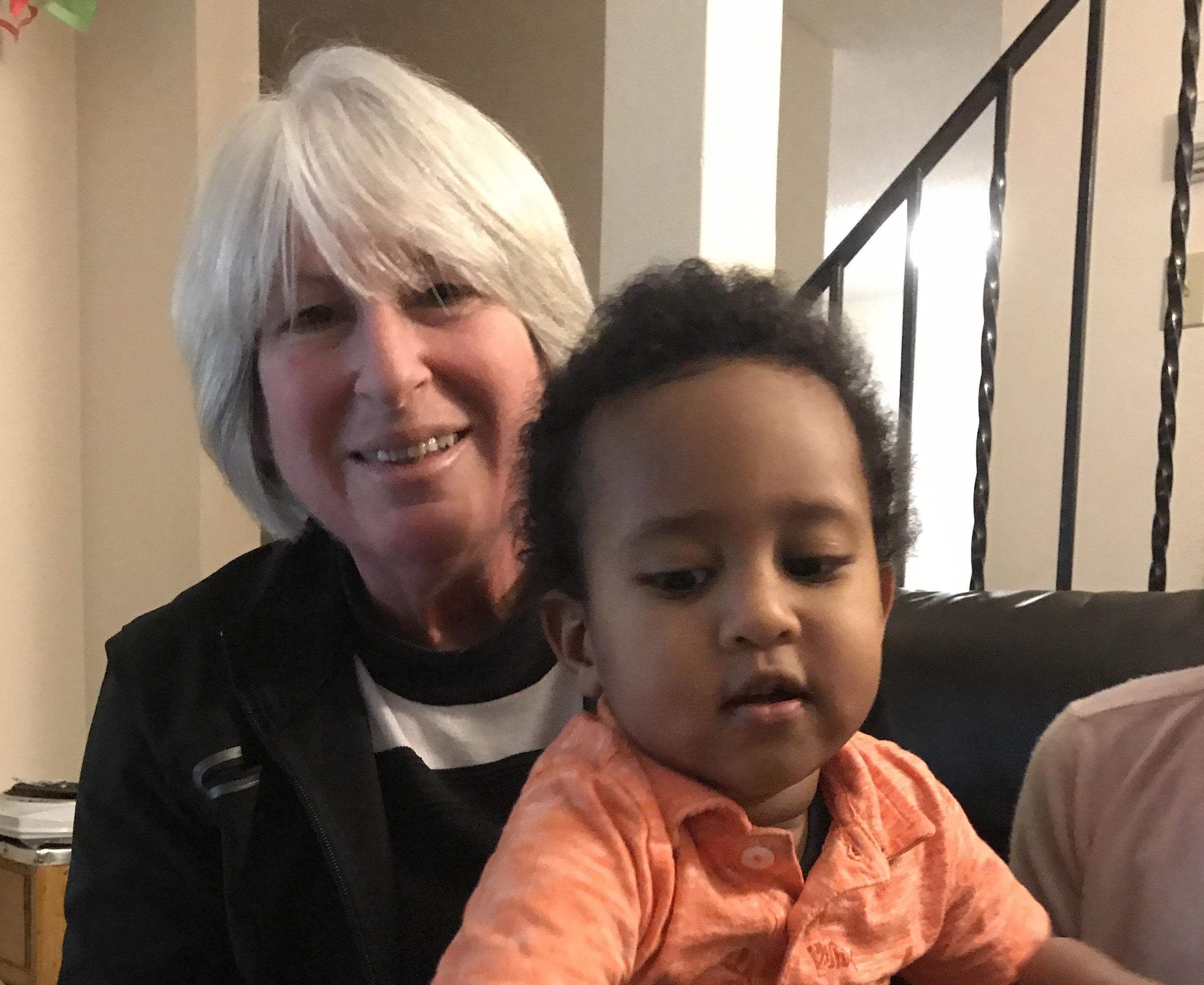 Mona Durkee holds Zechariah Tesfamichael in her lap. (Randi Beers/CBC)